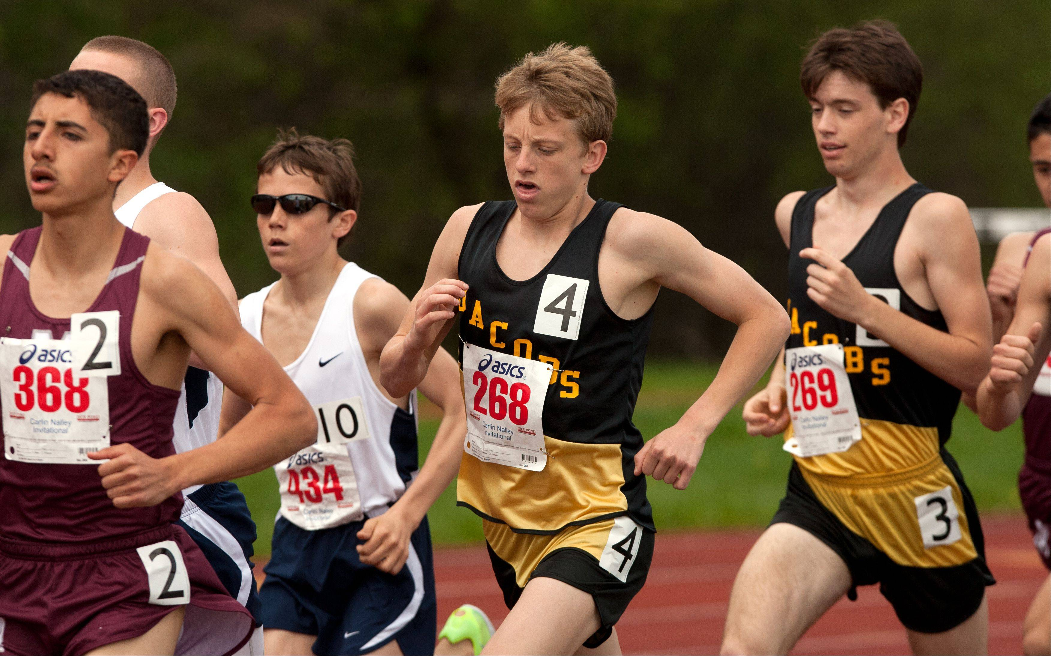 Jacobs' Matt Goldby and Matt Johnson, right, run the 3200 meter run during the 46th annual Carlin Nalley Boys´ Track Invitational at Benedictine University in Lisle.