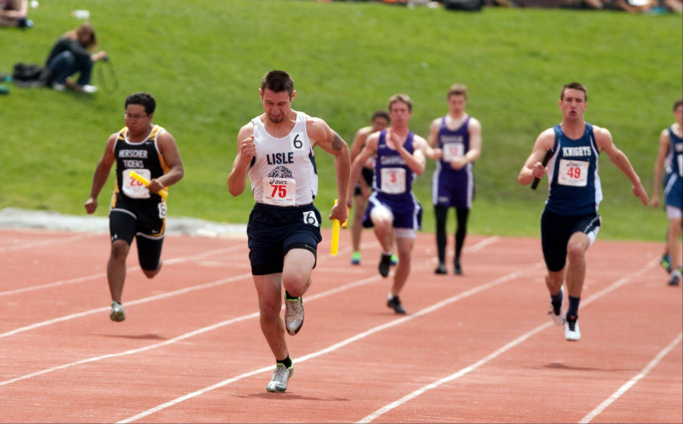 Lisle's Nick Rizzotti anchors a 4x100 meter relay win during the 46th annual Carlin Nalley Boys� Track Invitational at Benedictine University in Lisle.
