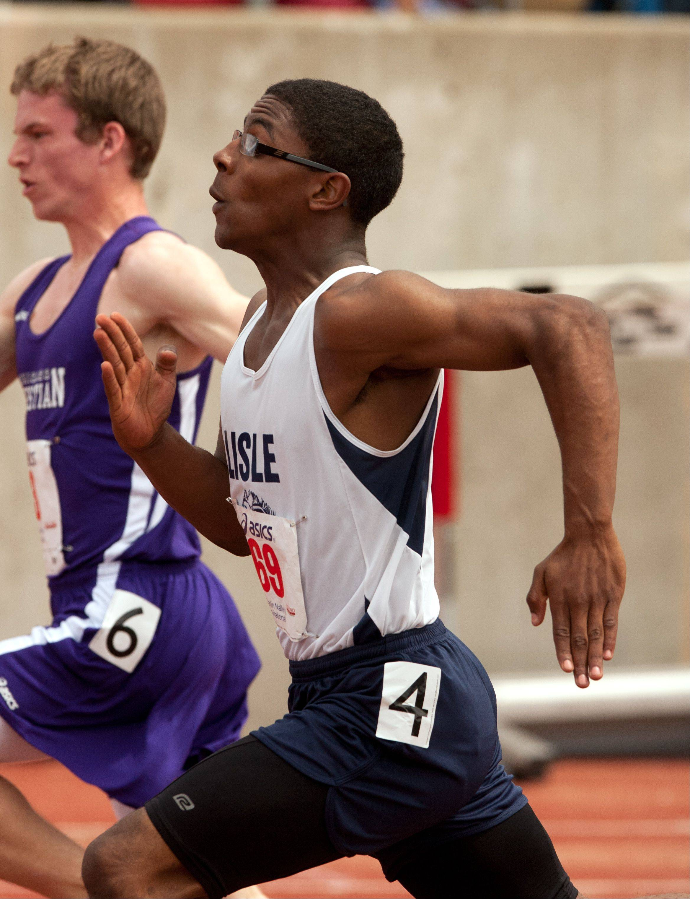 Lisle's Aaron Harris, right, competes in the 100 meter dash during the 46th annual Carlin Nalley Boys� Track Invitational at Benedictine University in Lisle.