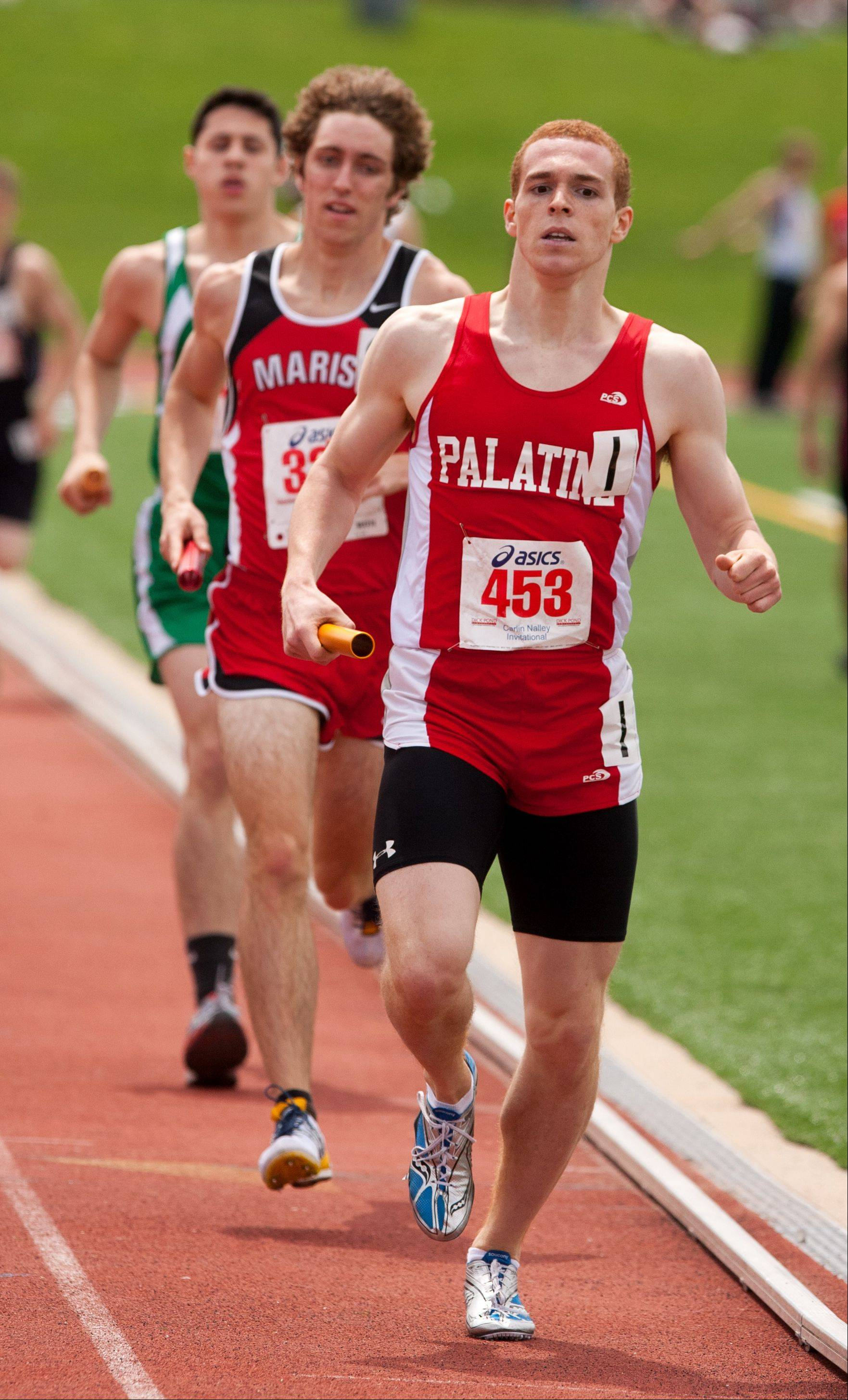 Palatine's Andrew Clingerman anchors a record breaking 4x800 meter relay win, during the 46th annual Carlin Nalley Boys´ Track Invitational at Benedictine University in Lisle. The Pirates ran a 7:49.99 time.