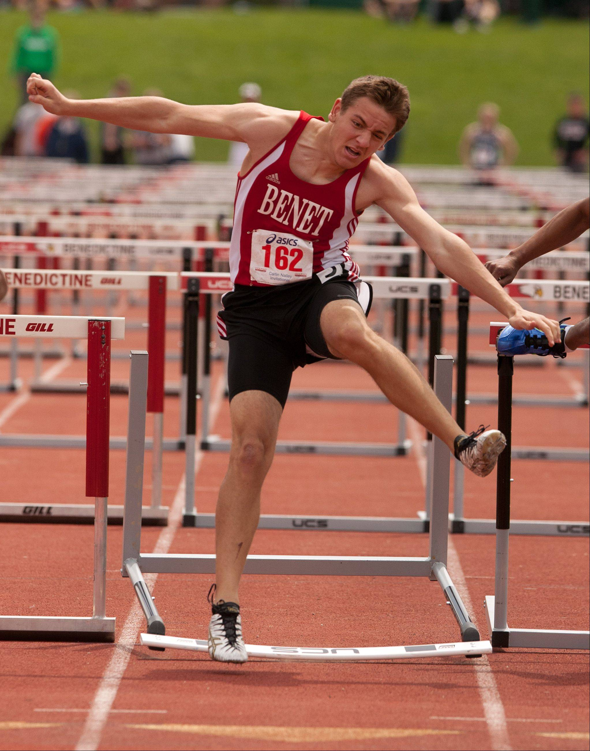 Benet's Austin Dzik competes in the 110 meter hurdles during the 46th annual Carlin Nalley Boys� Track Invitational at Benedictine University in Lisle.