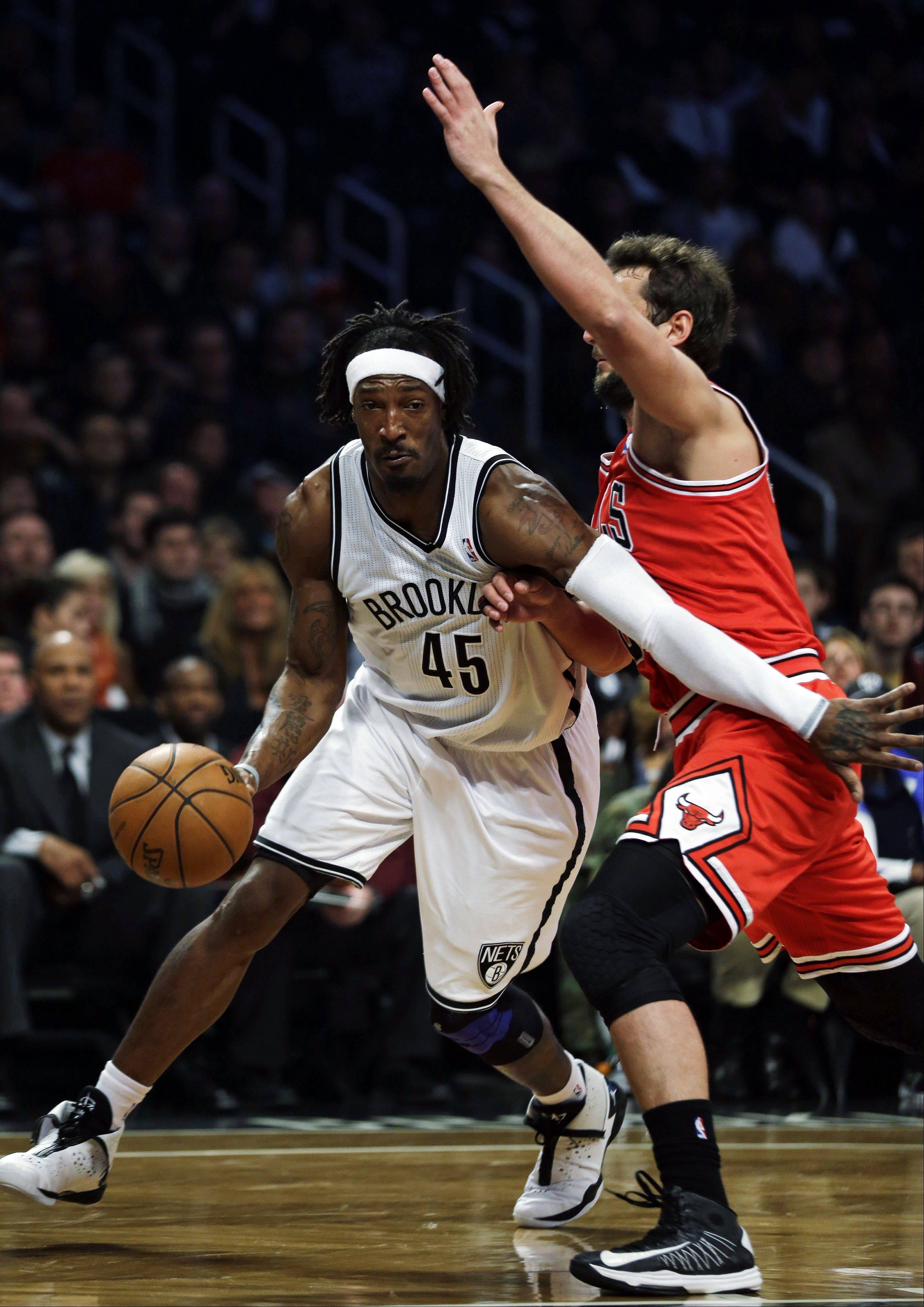 Brooklyn Nets forward Gerald Wallace, left, drives against Chicago Bulls guard Marco Belinelli during the first half in Game 7 of their first-round NBA basketball playoff series in New York, Saturday, May 4, 2013.