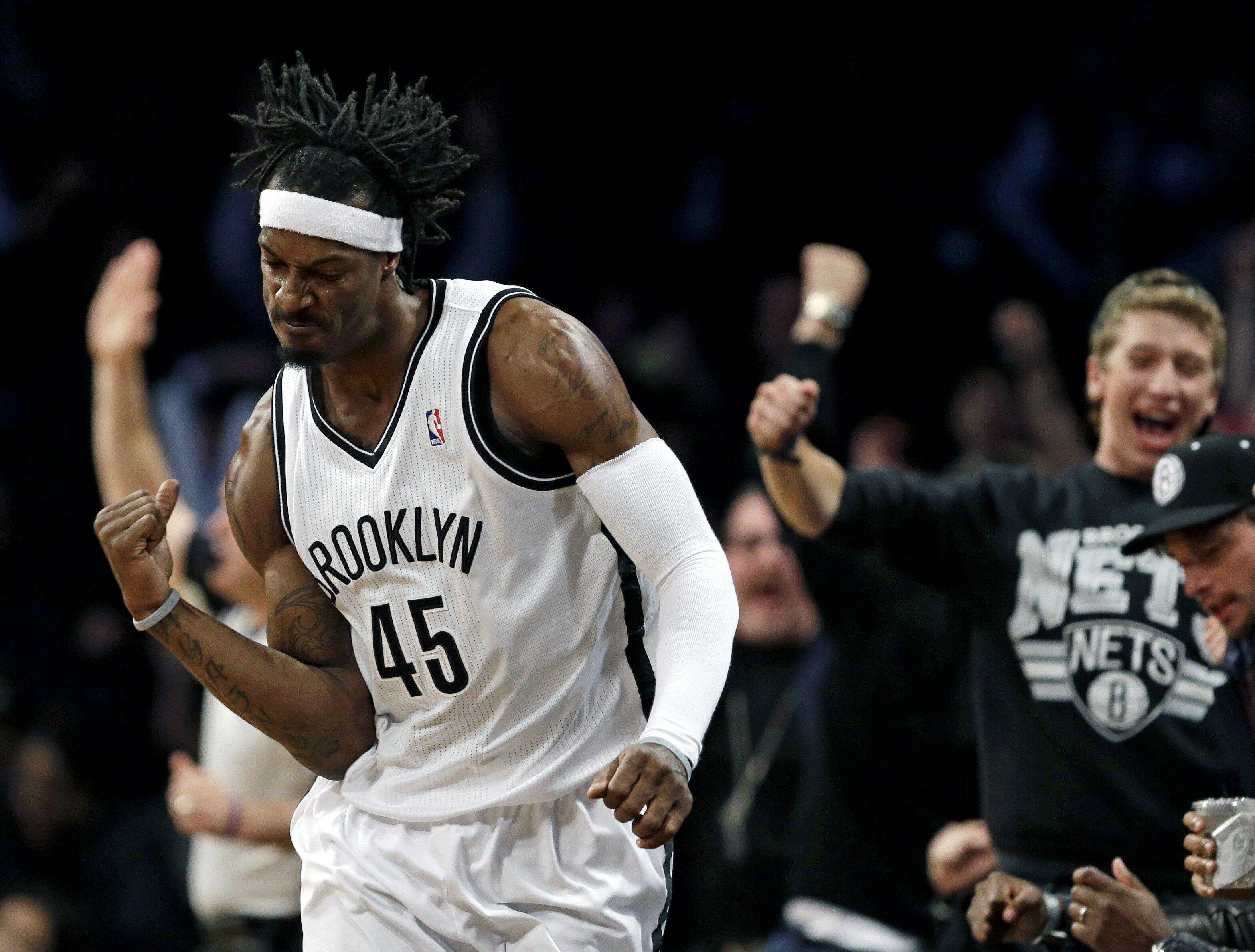 Associated Press Brooklyn Nets' Gerald Wallace celebrates after sinking a 3-point shot against the Chicago Bulls during the second half in Game 7 of their first-round NBA basketball playoff series in New York, Saturday, May 4, 2013.