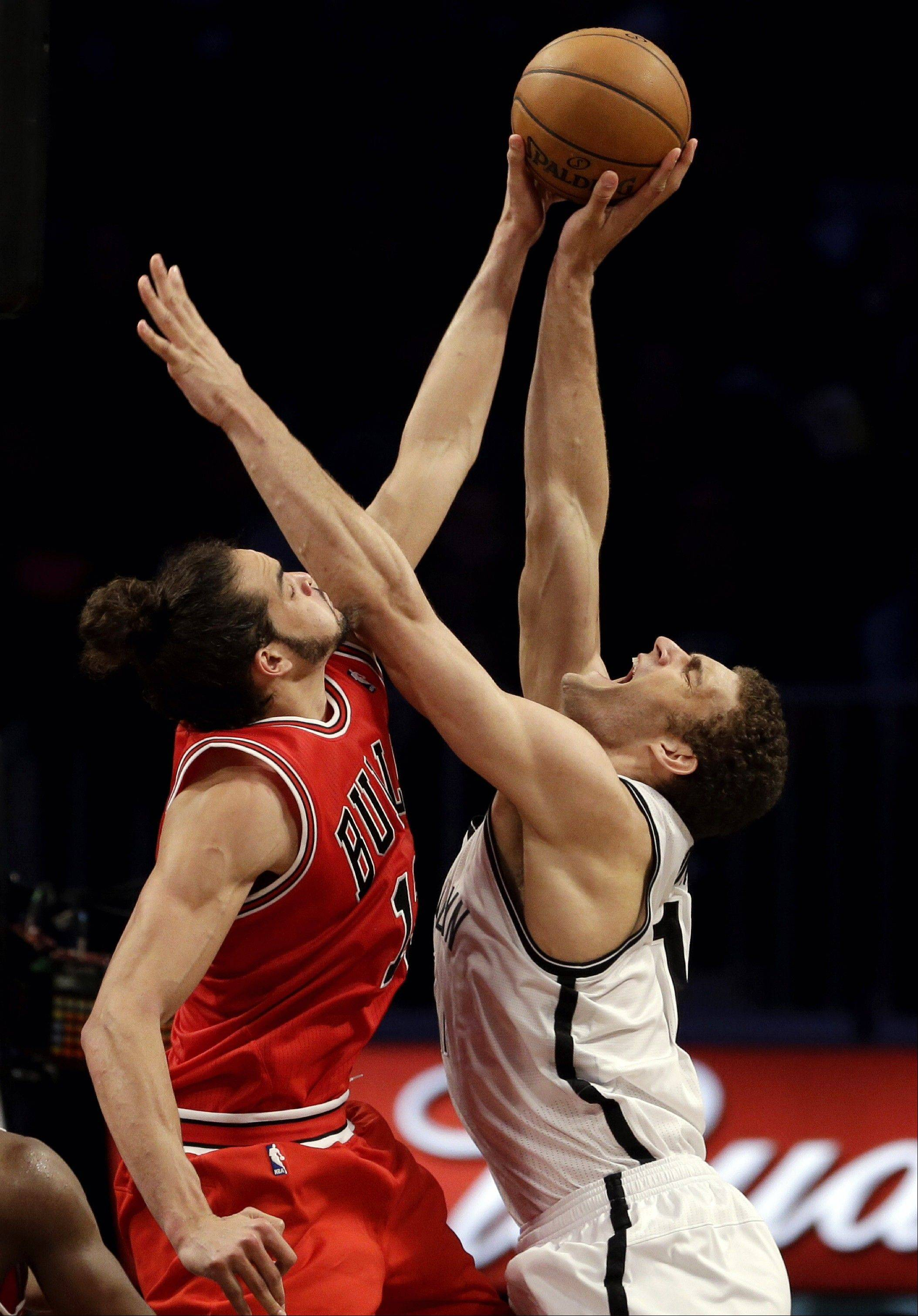 Associated Press Chicago Bulls center Joakim Noah, left, blocks Brooklyn Nets center Brook Lopez during the second half in Game 7 of their first-round NBA basketball playoff series in New York, Saturday, May 4, 2013.