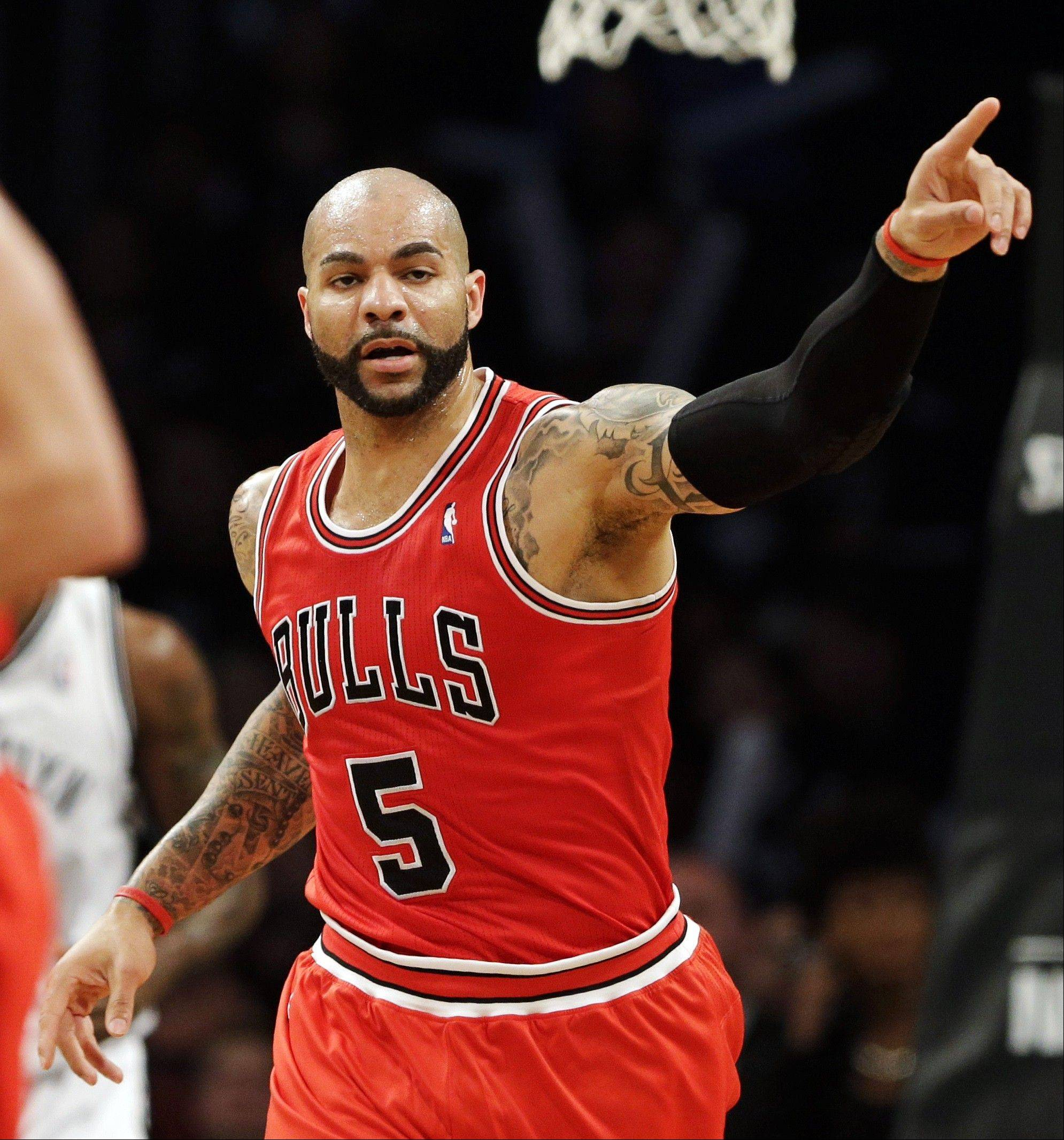 Chicago Bulls forward Carlos Boozer celebrates scoring against the Brooklyn Nets during the first half in Game 7 of their first-round NBA basketball playoff series in New York, Saturday, May 4, 2013.