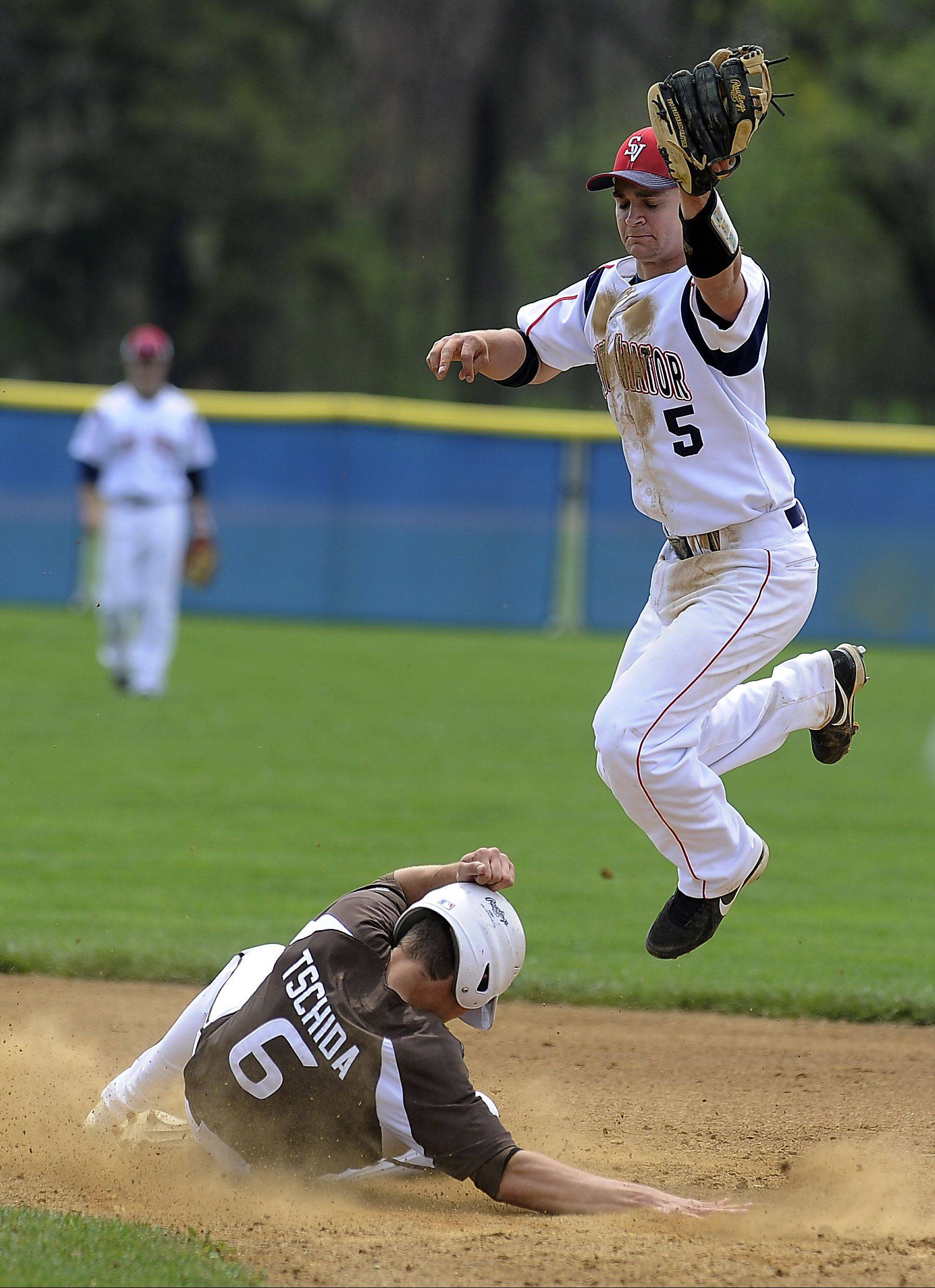 St. Viator's Charlie Meyer is unable to apply the tag at second as Joliet's Chris Tschida slides safely in at St. Viator on Saturday.