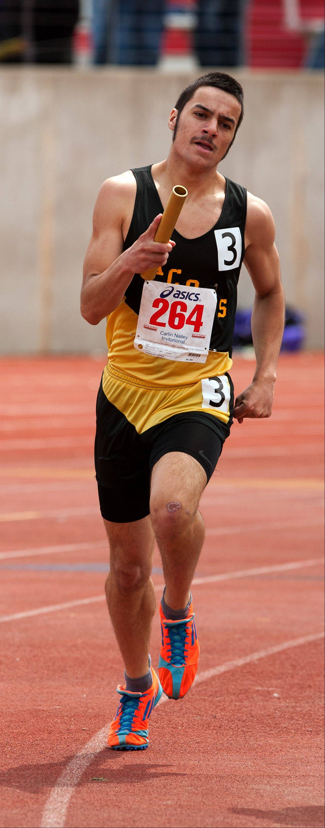 Jacobs' Nick Matysek anchors the Golden Eagles' 3,200-meter relay run during the 46th annual Carlin Nalley Boys´ Track Invitational at Benedictine University in Lisle Saturday.
