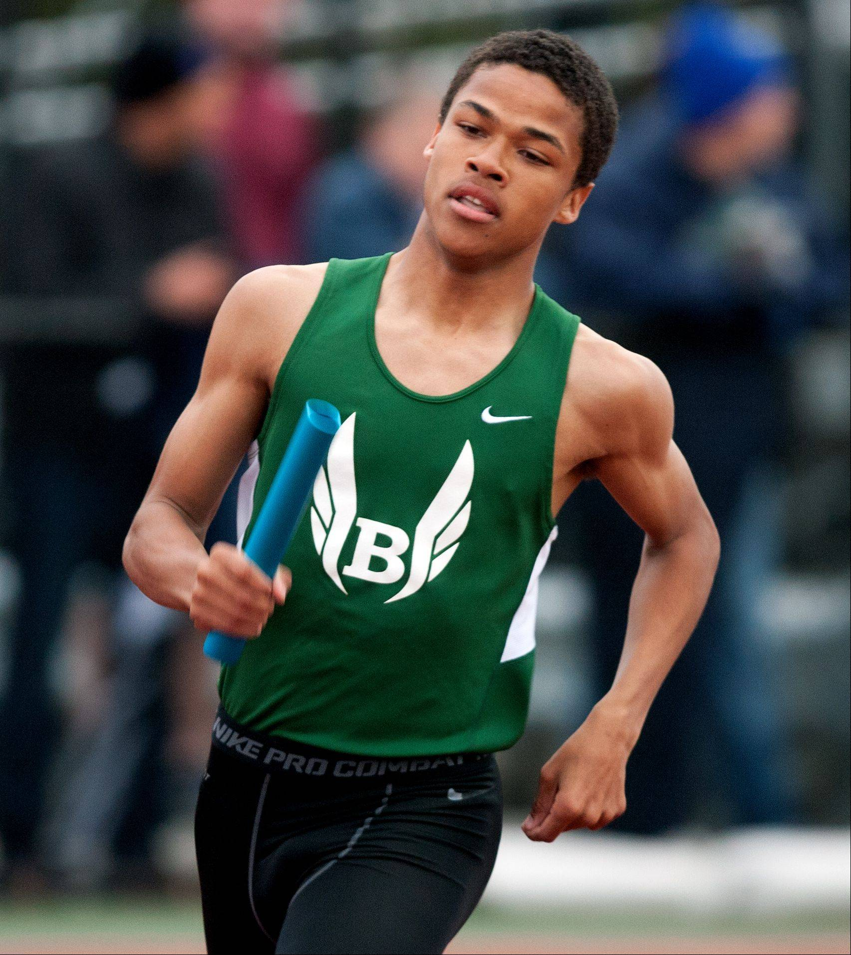 Bartlett's Brandon Smith anchors the Hawks' 3,200-meter relay win during the DuPage County boys track invitational at York High School Friday.