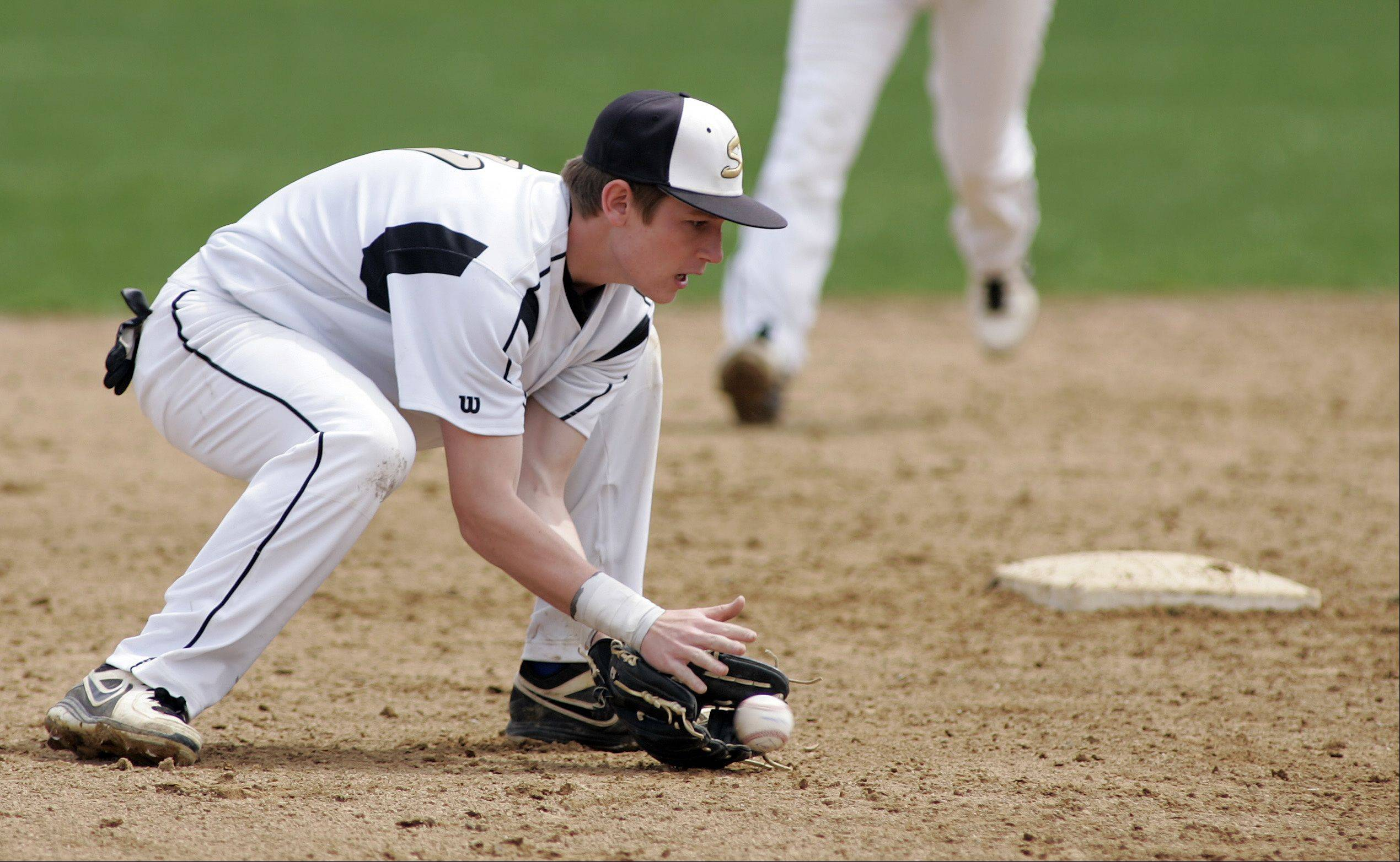 Streamwood's Michael Smith, 11 pulls in a grounder Saturday.