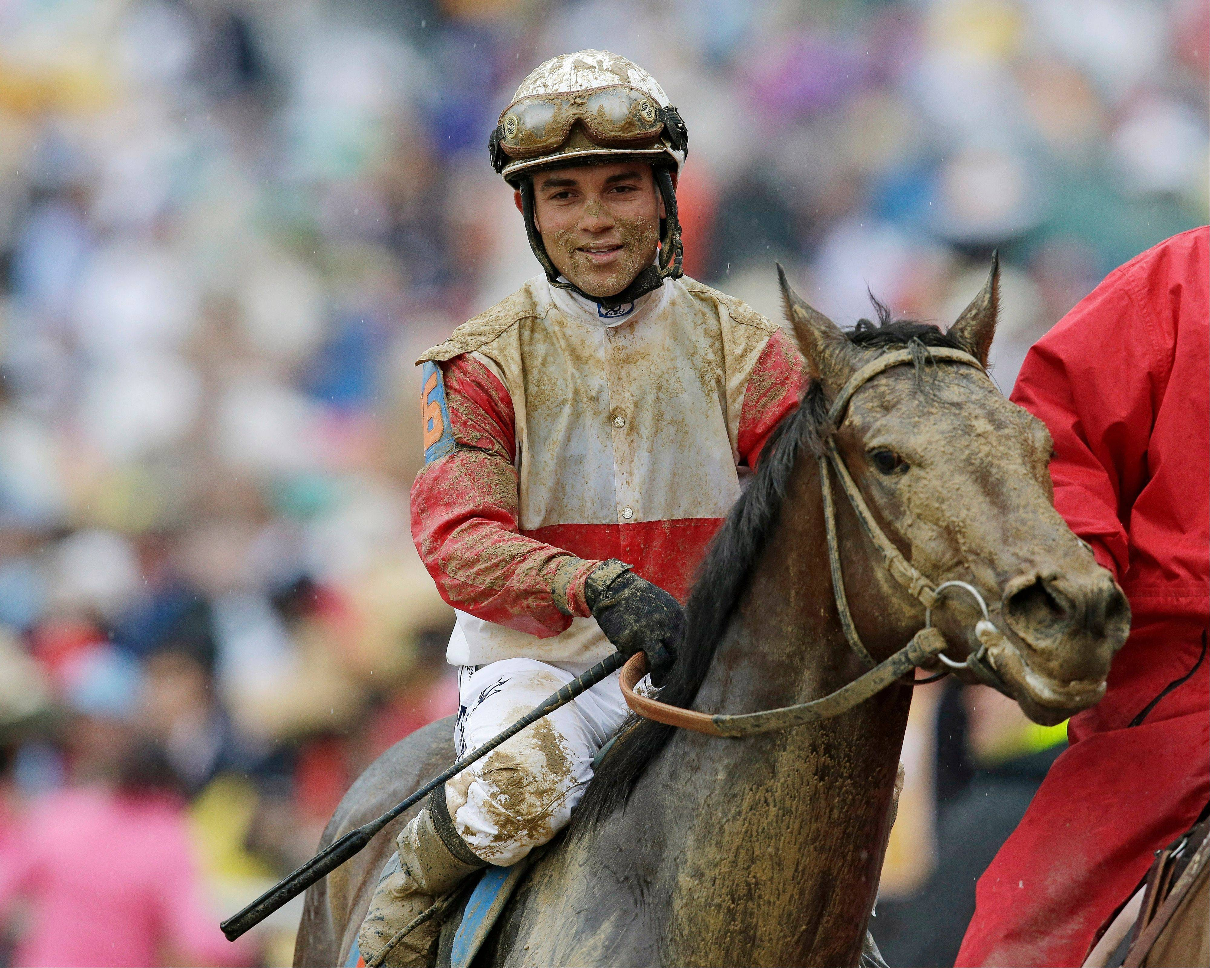 Joel Rosario reacts after riding Orb to victory in the 139th Kentucky Derby at Churchill Downs Saturday, May 4, 2013, in Louisville, Ky.