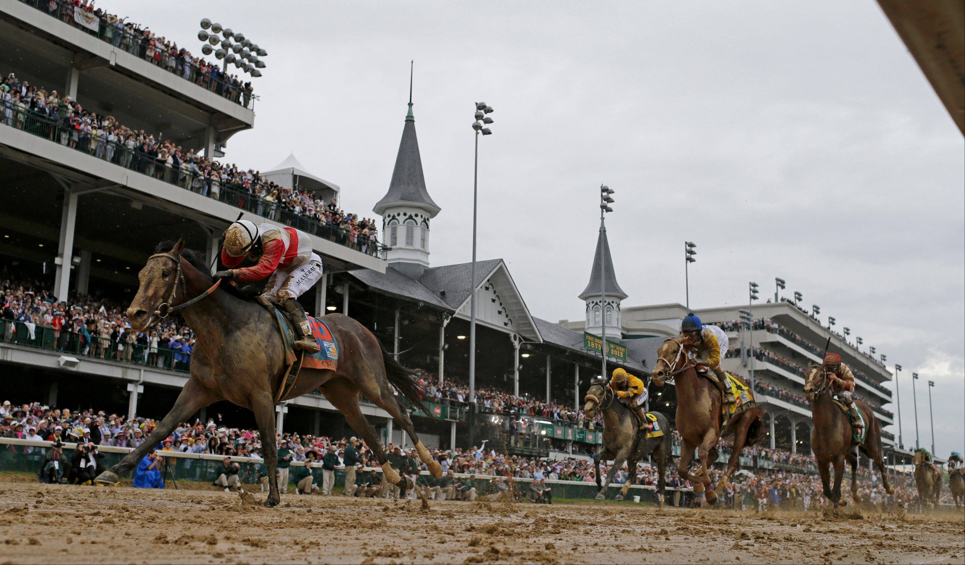 Joel Rosario rides Orb to victory during the 139th Kentucky Derby at Churchill Downs Saturday, May 4, 2013, in Louisville, Ky.