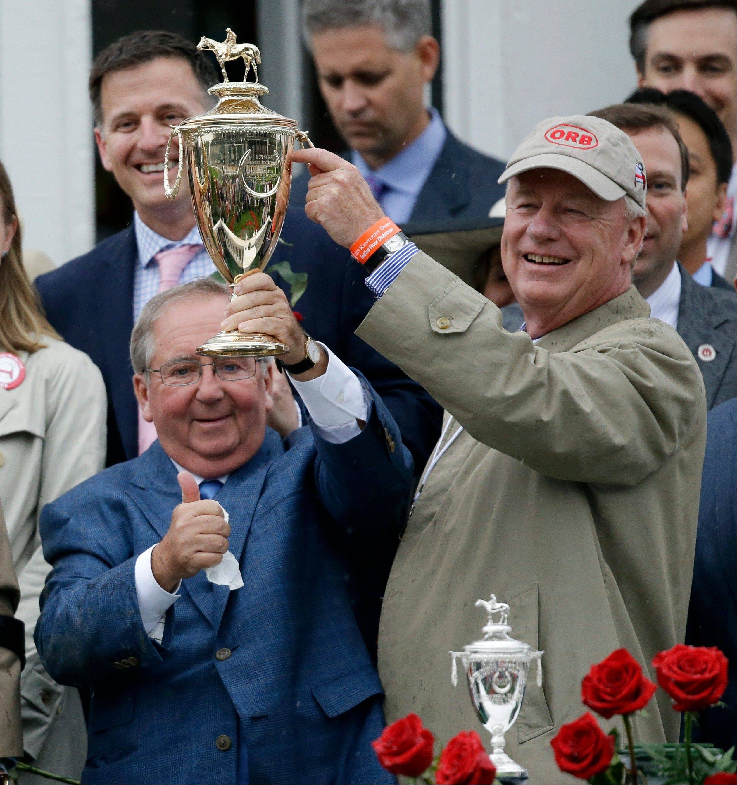 Orb owner Stuart Janney and trainer Claude McGaughey, left, celebrate after winning the 139th Kentucky Derby at Churchill Downs Saturday, May 4, 2013, in Louisville, Ky.