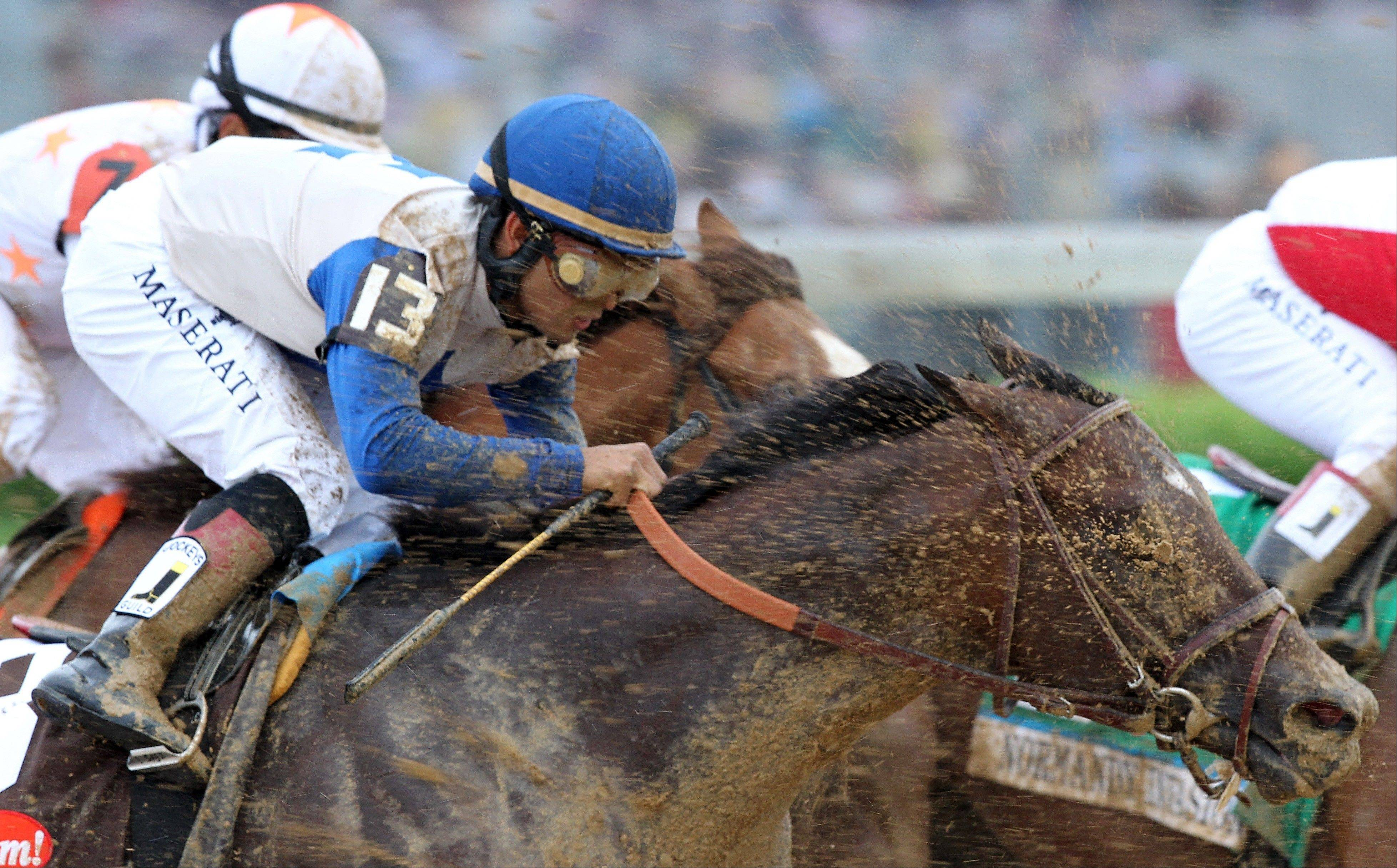 Luis Saez rides Falling Sky during the 139th Kentucky Derby at Churchill Downs Saturday, May 4, 2013, in Louisville, Ky.