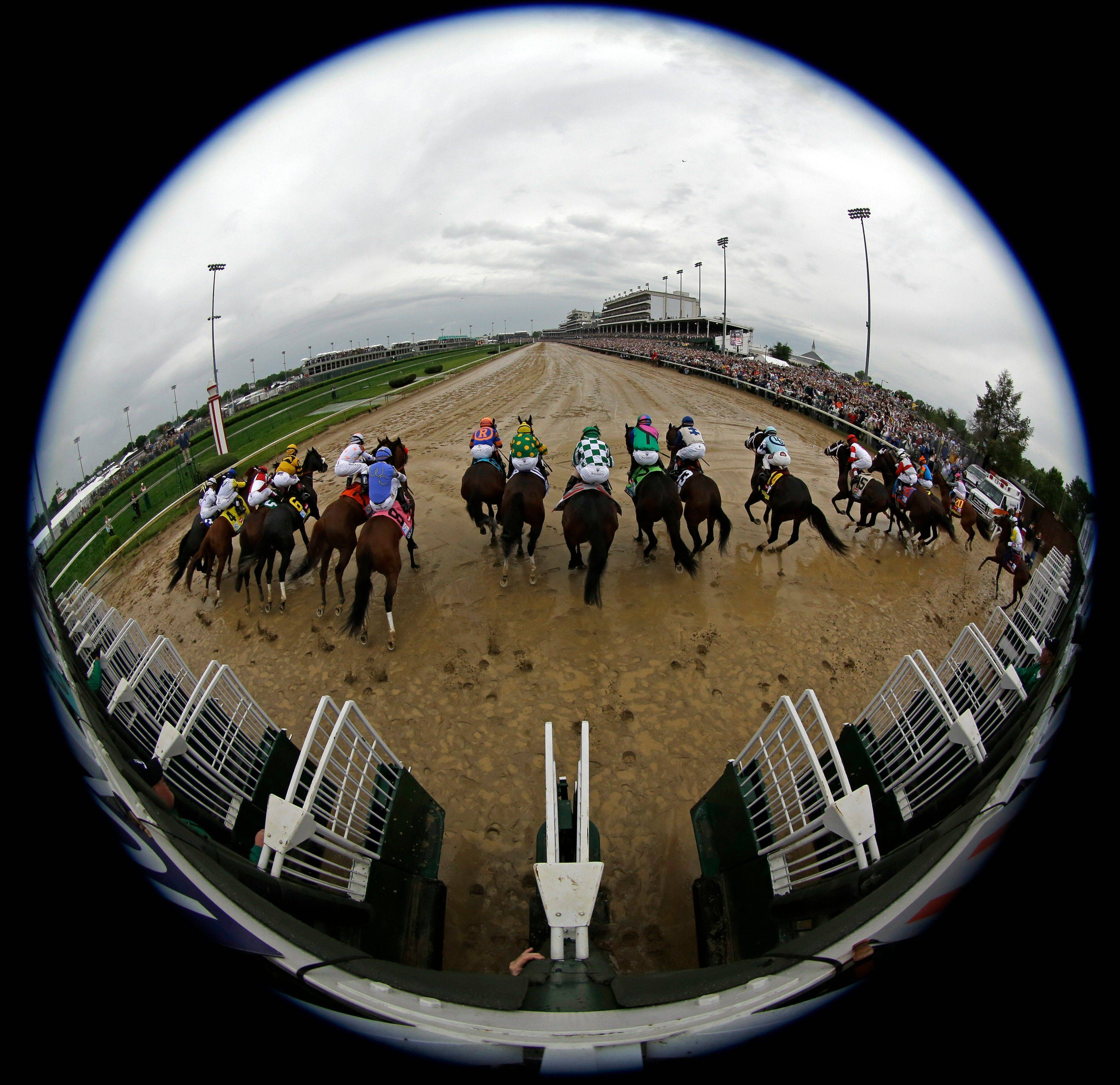 In this image taken with a fisheye lens, horses leave the starting gate during the 139th Kentucky Derby at Churchill Downs Saturday, May 4, 2013, in Louisville, Ky.