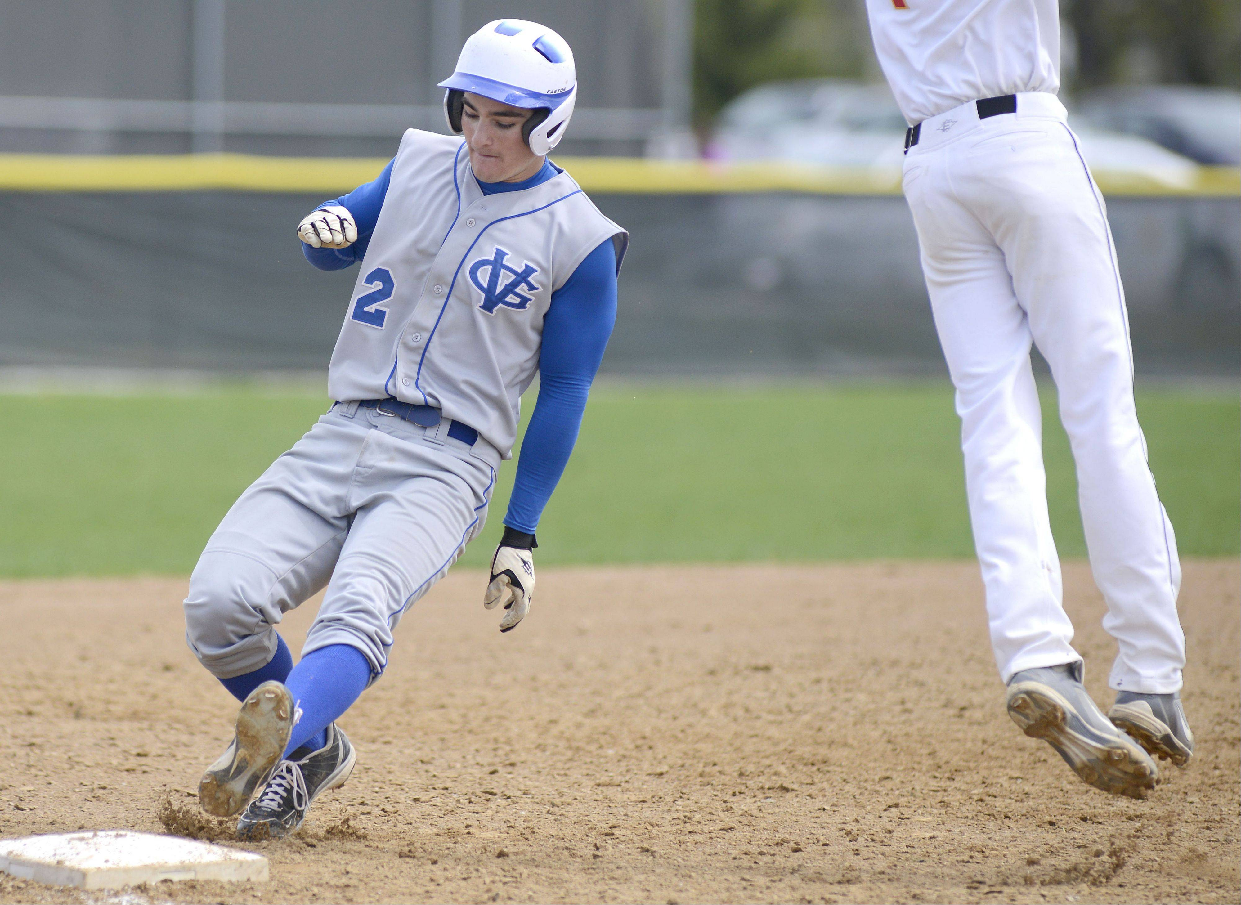 Geneva's Bobby Hess is safe on second as Batavia's Andrew Seigler leaps for the ball in the sixth inning on Saturday, May 4.