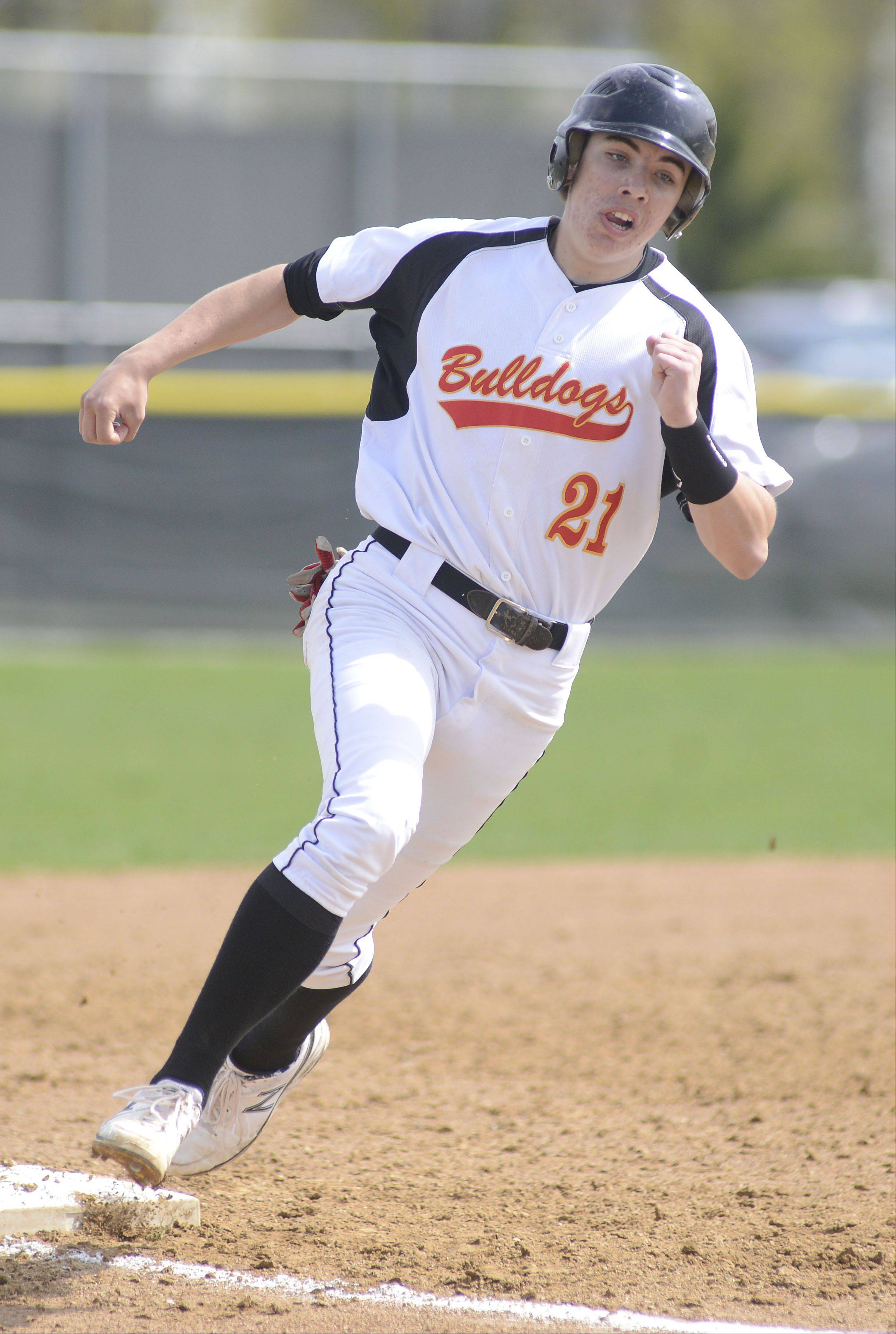 Batavia's Jeremy Schoessling rounds third base on the way to scoring a run for the Bulldogs in the fourth inning on Saturday, May 4.