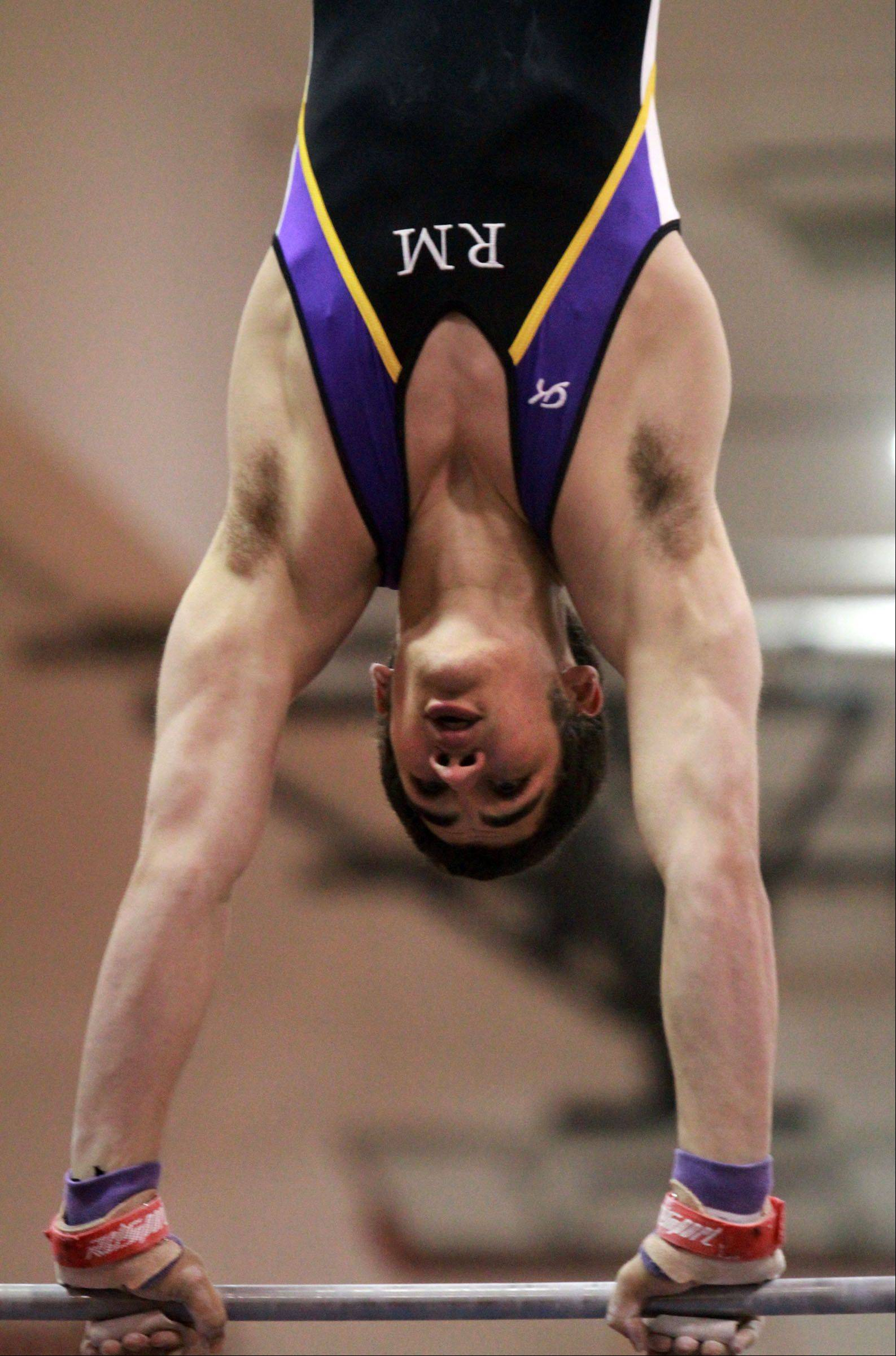 Rolling Meadows Matt Crigler competes on the horizontal bar in Mundelein boys gymnastics sectional on Saturday.