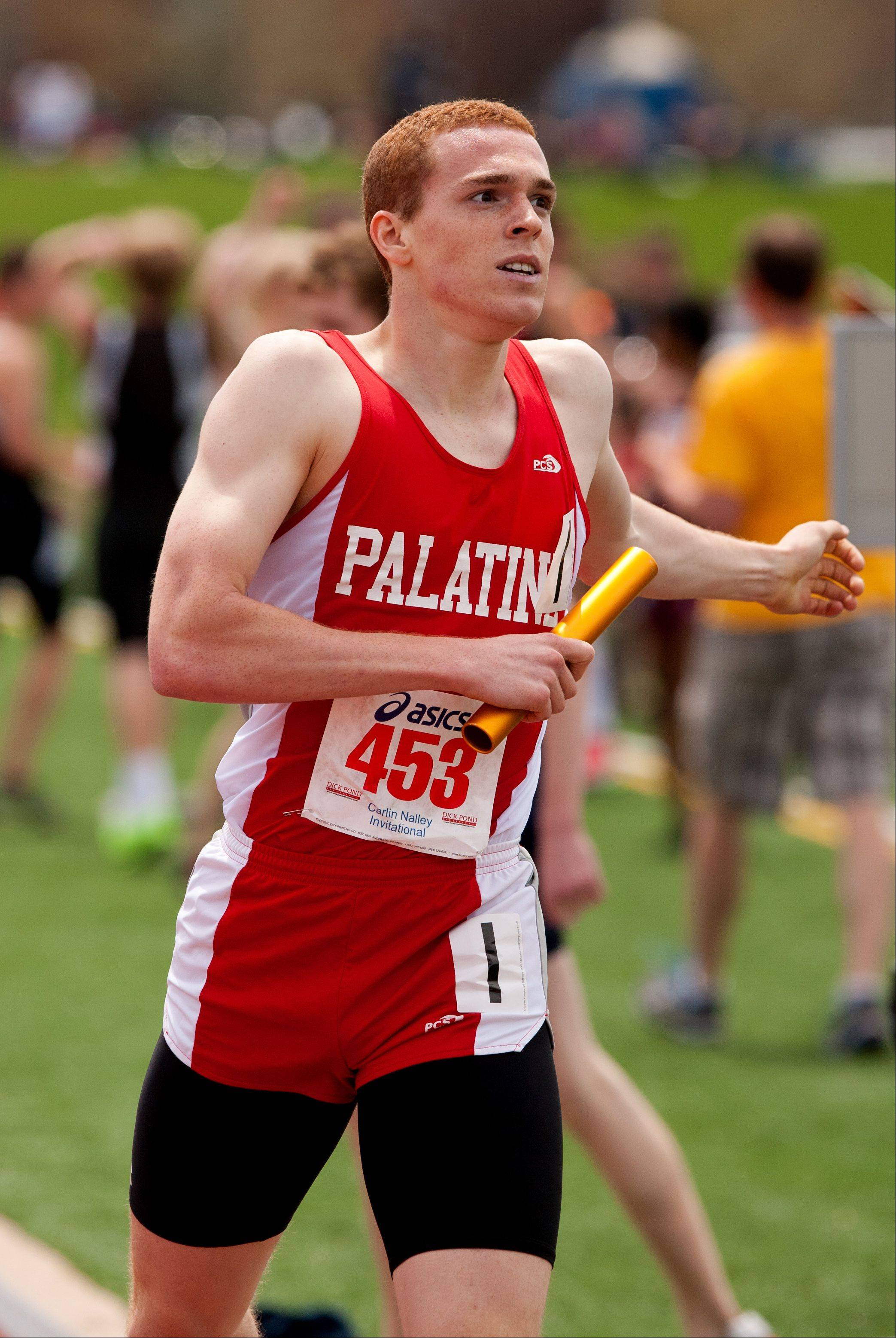 Palatine's Andrew Clingerman anchors a record-breaking 4x800-meter relay win during the 46th annual Carlin Nalley Invitational at Benedictine University in Lisle. The Pirates finished in 7:50.00.