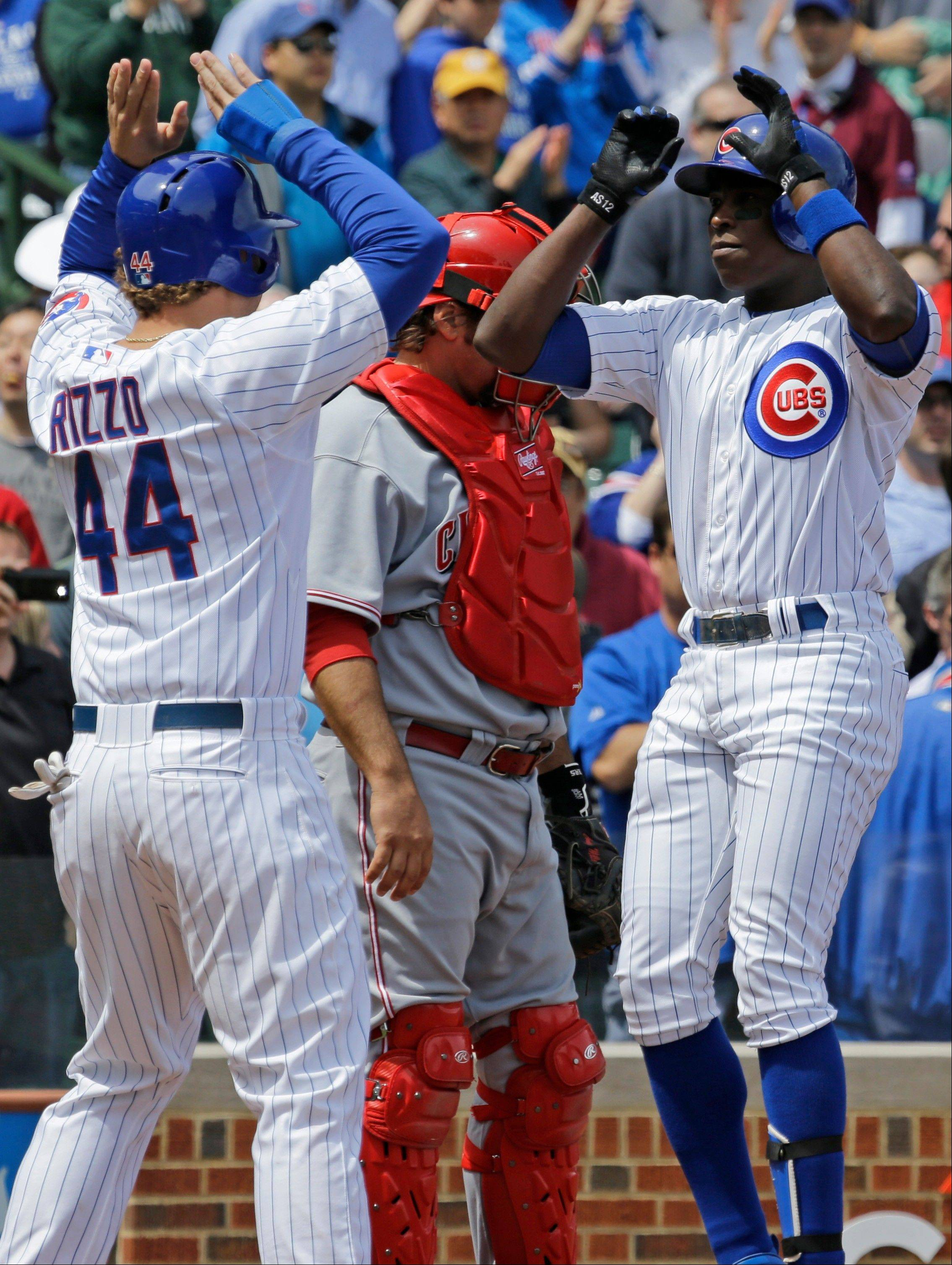 Alfonso Soriano, right, celebrates with Anthony Rizzo after hitting a two-run home run during the first inning of a baseball game against the Cincinnati Reds in Chicago, Saturday, May 4, 2013.