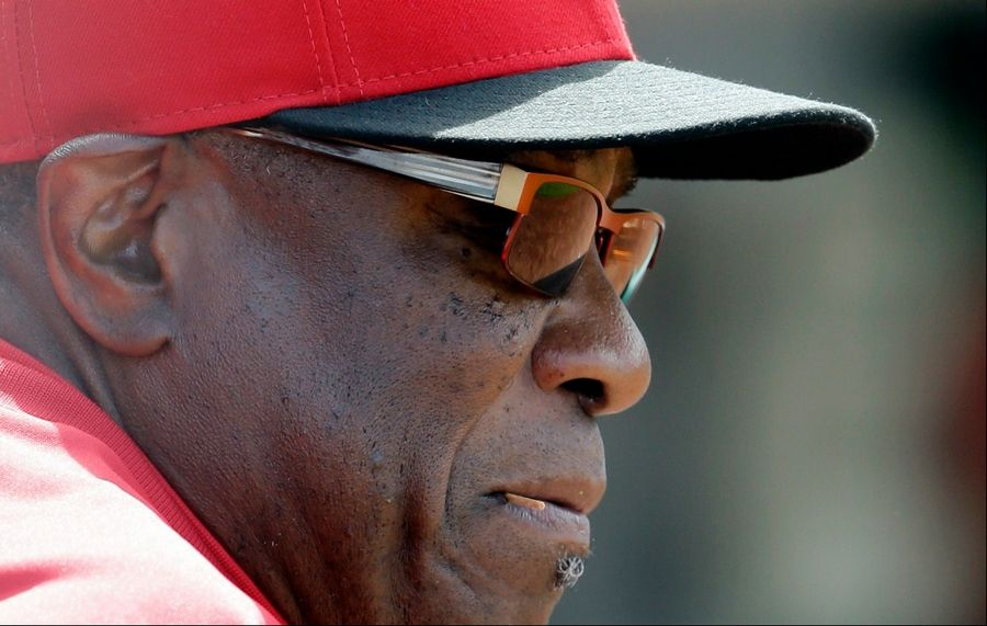 Cincinnati Reds manager Dusty Baker watches his team during the eighth inning of a baseball game against the Chicago Cubs in Chicago, Saturday, May 4, 2013.