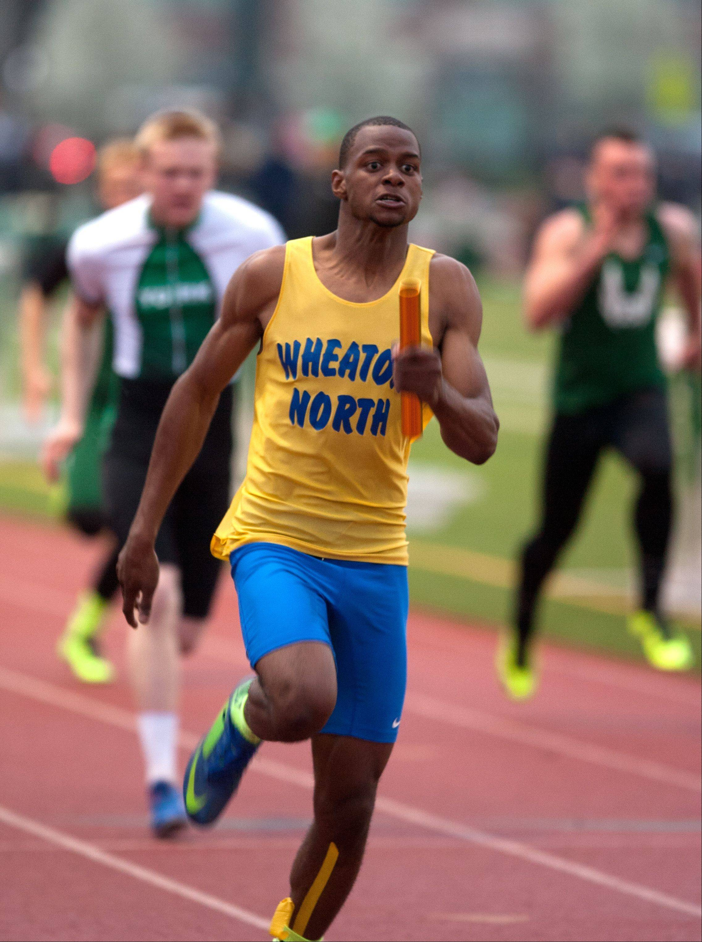 Wheaton North's Zach Gordon anchors a win in the second heat of the 4x100 meter run, during the DuPage County boys track invitational at York High School.