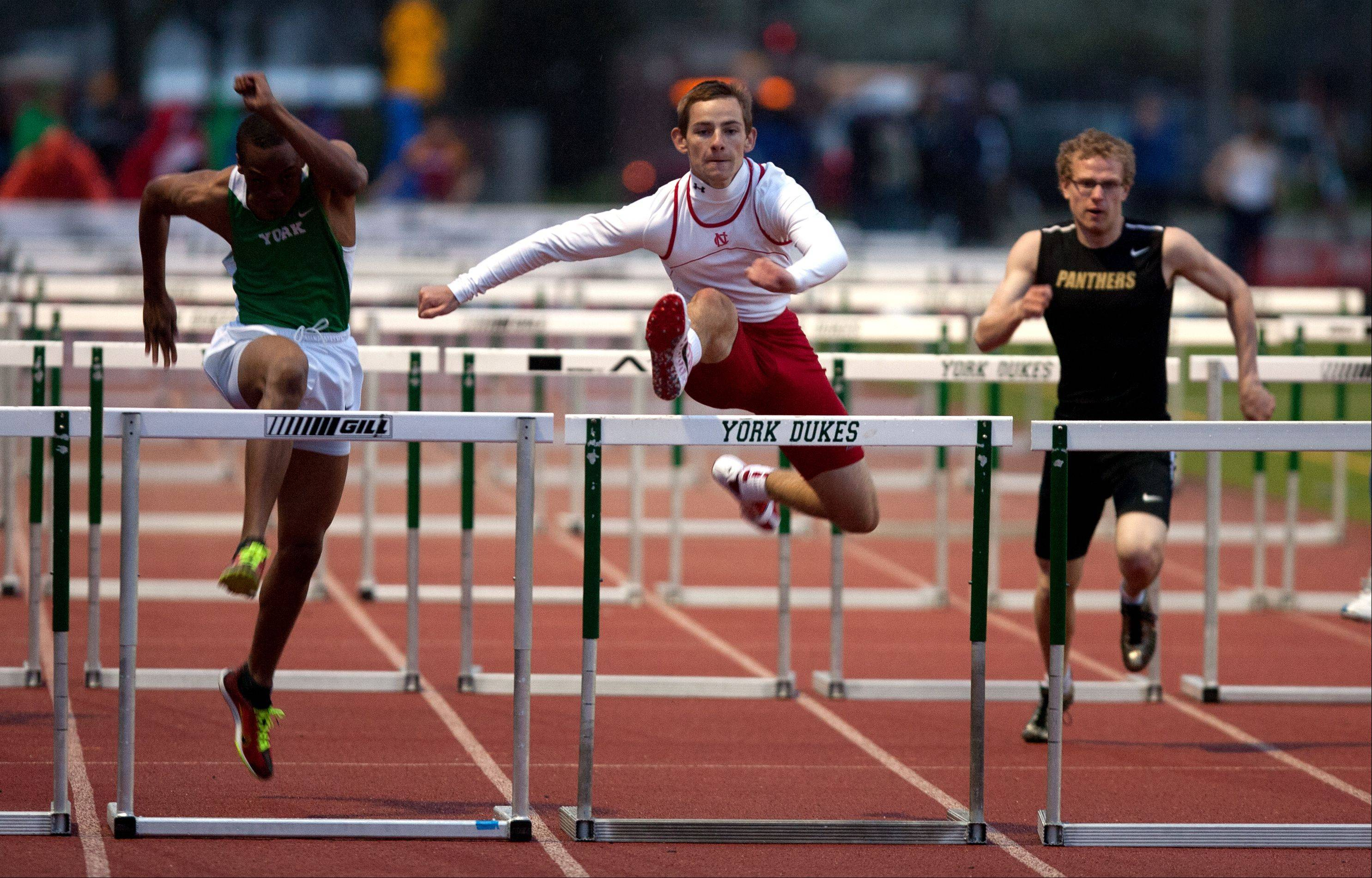 Naperville Central's Mike Jopes wins the 110 meter high hurdles, during the DuPage County boys track invitational at York High School.