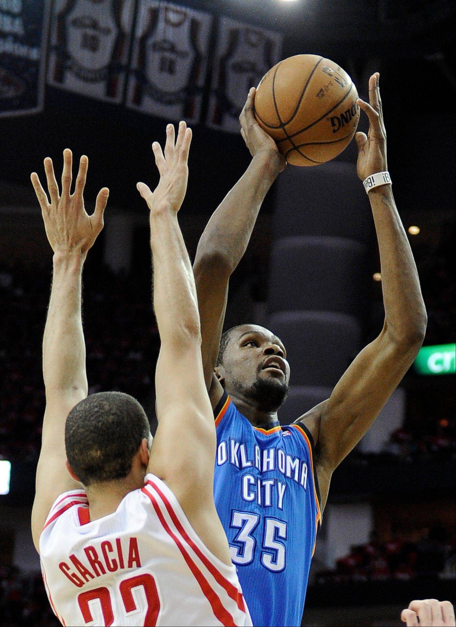 Oklahoma City Thunder's Kevin Durant (35) shoots in front of Houston Rockets' Francisco Garcia (32) in the first quarter of Game 6 in a first-round NBA basketball playoff series Friday, May 3, 2013, in Houston.
