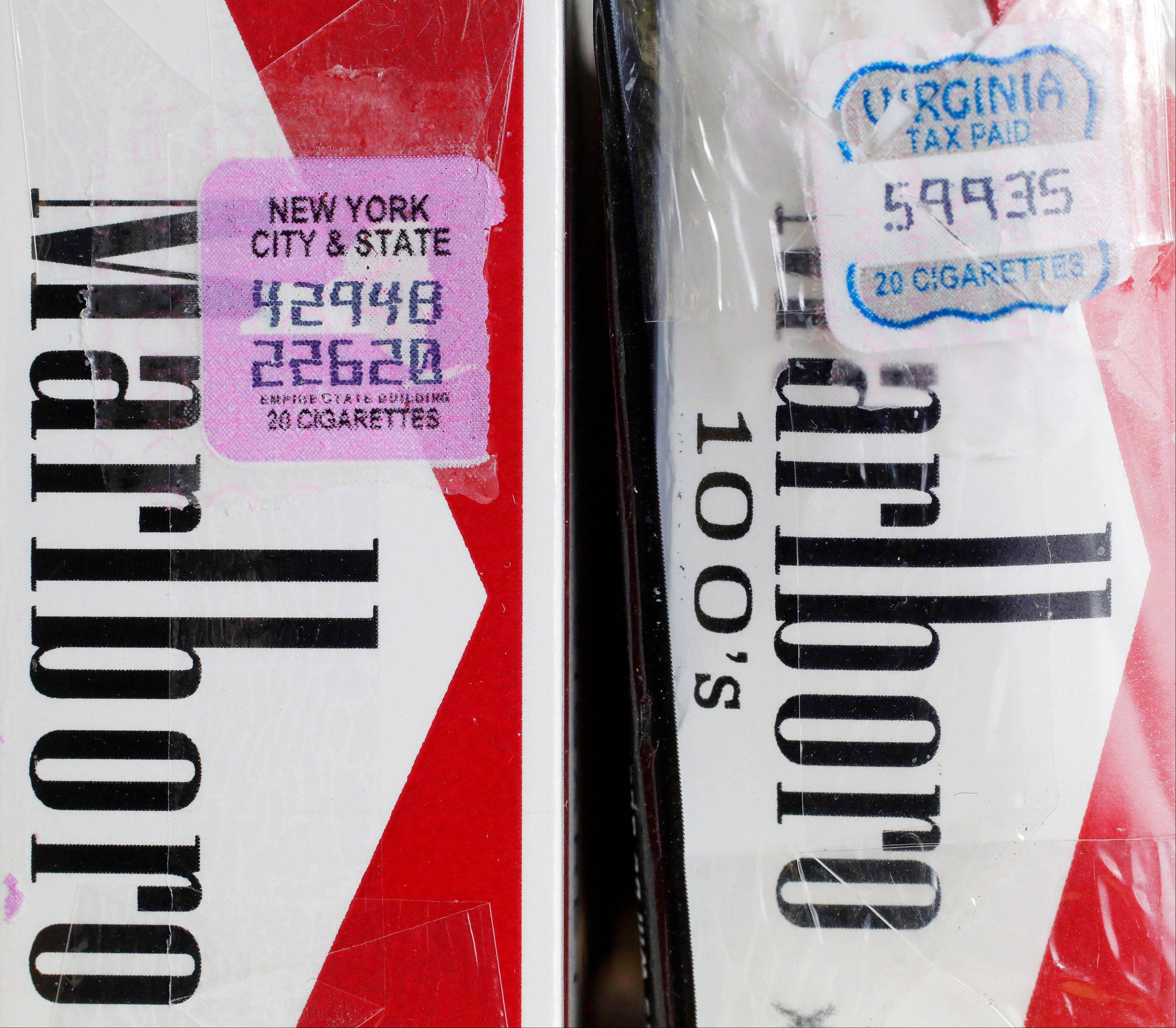 Two packs of Marlboro cigarettes are seen here, the one on the left with a New York City and state tax stamp, and on the right a Virginia tax stamp. New York City�s war on smoking is being undercut by light penalties for merchants caught selling cheap cigarettes smuggled in from low-tax states.