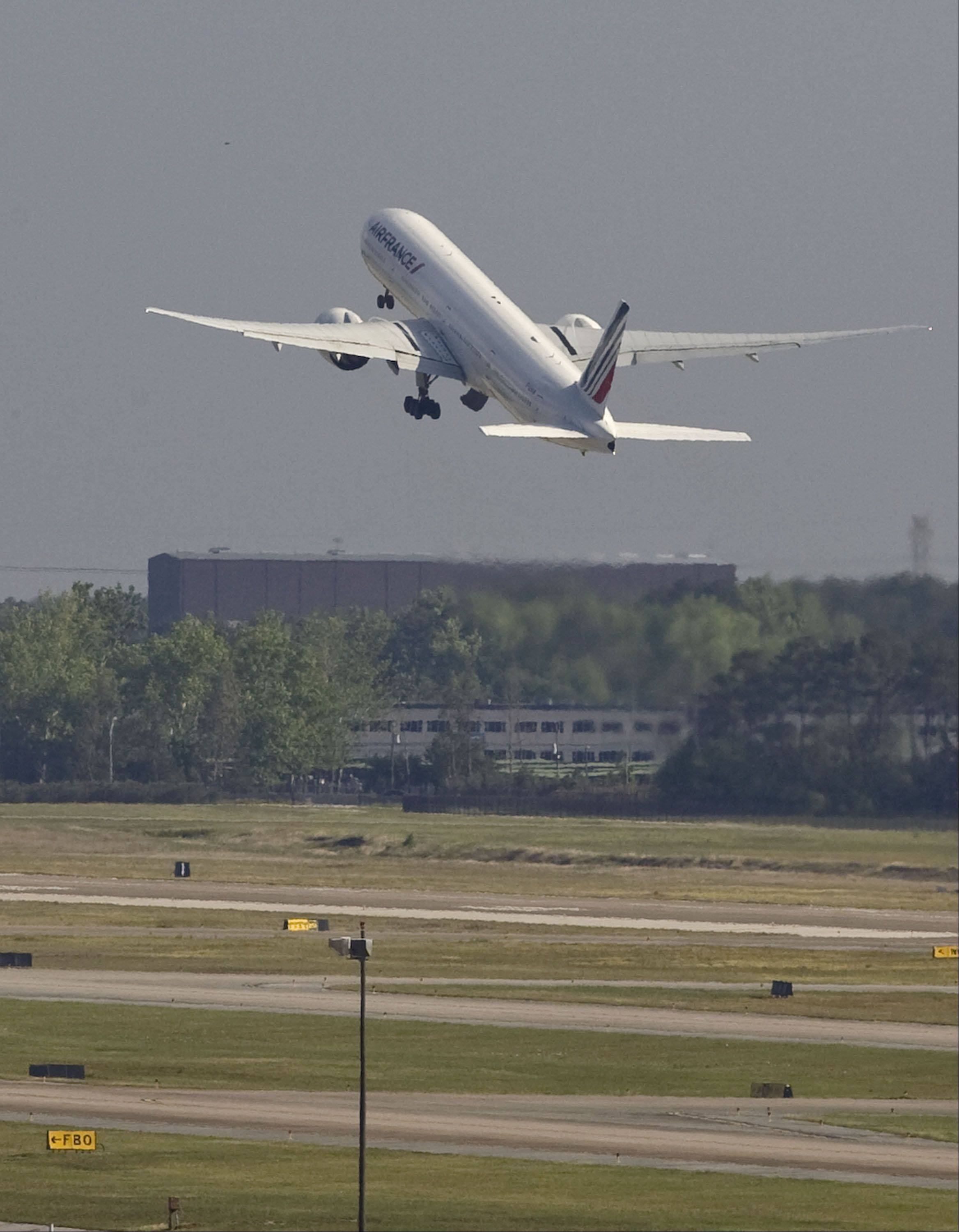 An Air France Boeing 777 takes off from Houston's Bush Intercontinental Airport on its way to Paris, France.