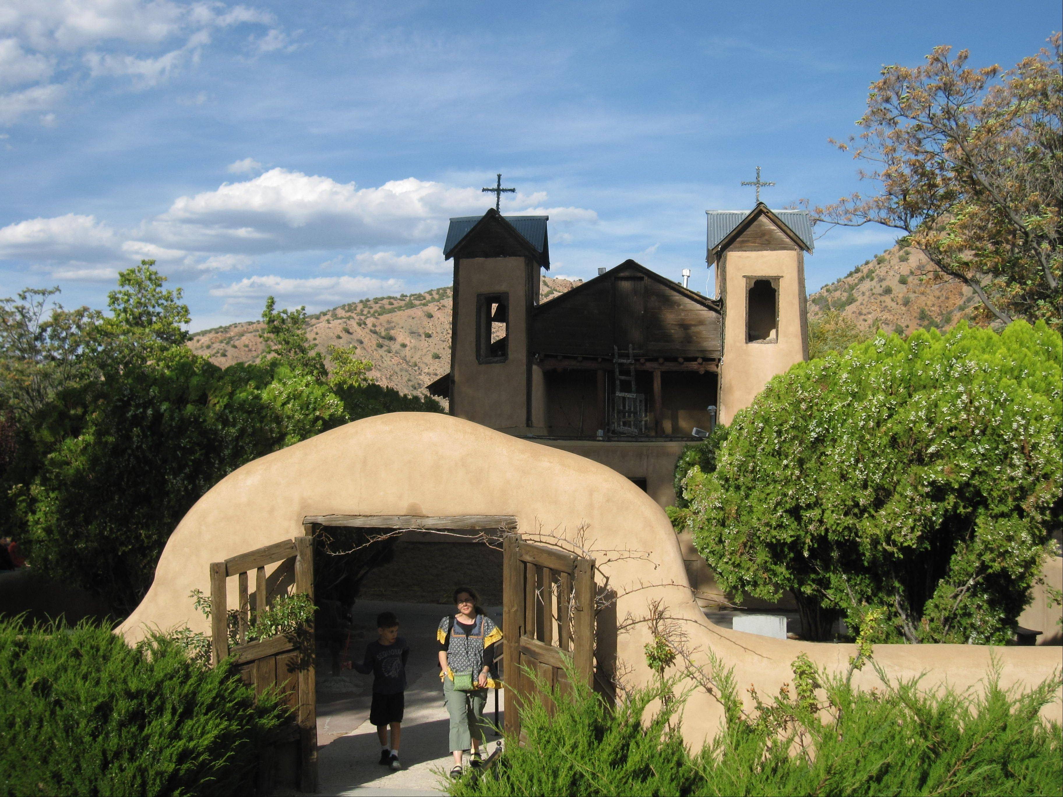 The Santuario de Chimayo, a 200-year-old National Historic Landmark, attracts 200,000 visitors a year, many of whom seek cures and miracles from a well of holy dirt.