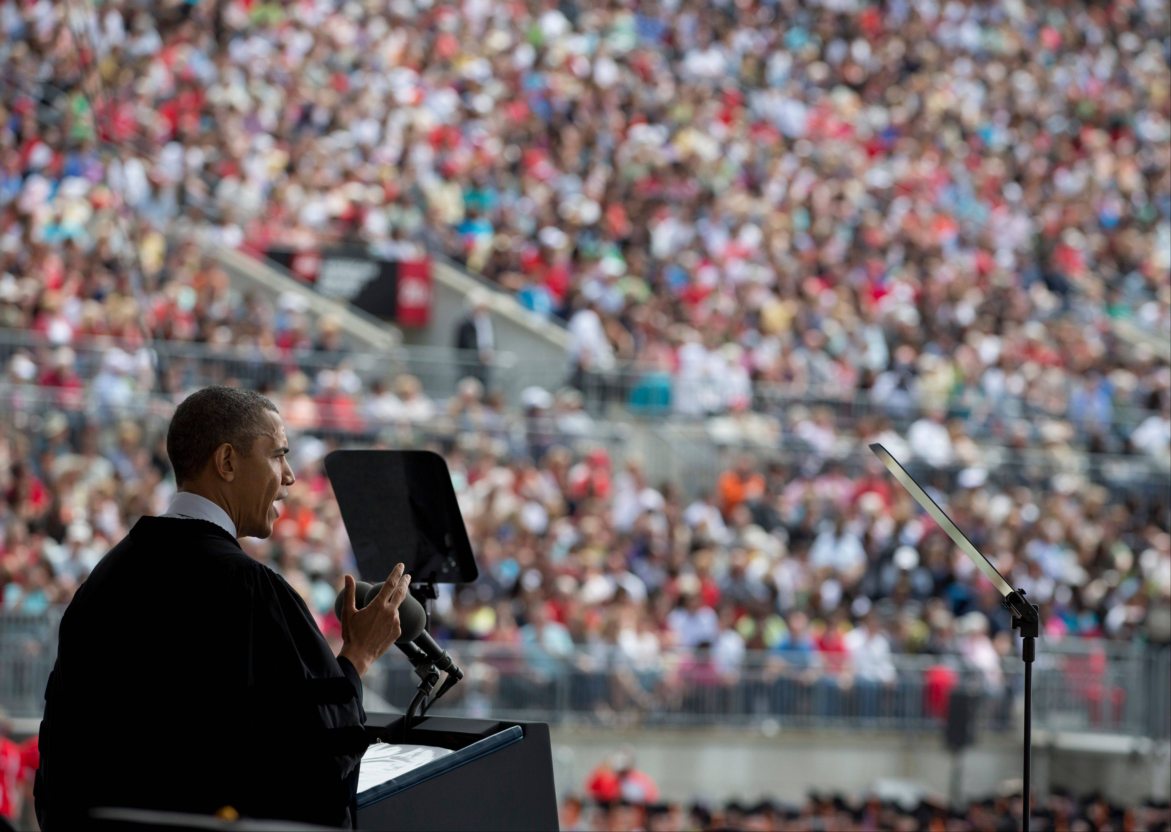 President Barack Obama speaks during the Ohio State University spring commencement in the Ohio Stadium Sunday in Columbus, Ohio. Obama delivered the commencement address before receiving an honorary doctor of law degree. He urged graduating students to be active citizens, to fight for causes they believe in, and to be better than generations before them.