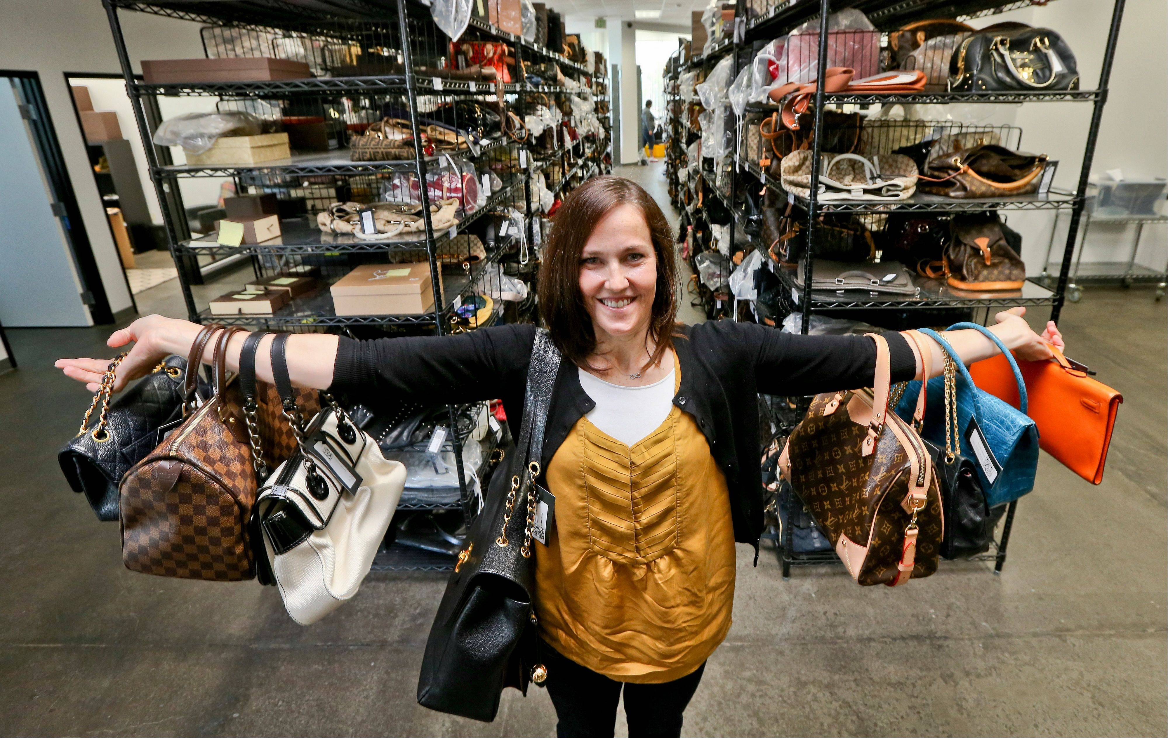 Sarah Davis, co-owner of Fashionphile.com, poses with her bags in a company warehouse in the Carlsbad, Calif. The Internet company sells rare, vintage, and discontinued previous owned bags and is facing the complicated task of dealing with new state regulations on Internet sale taxes.