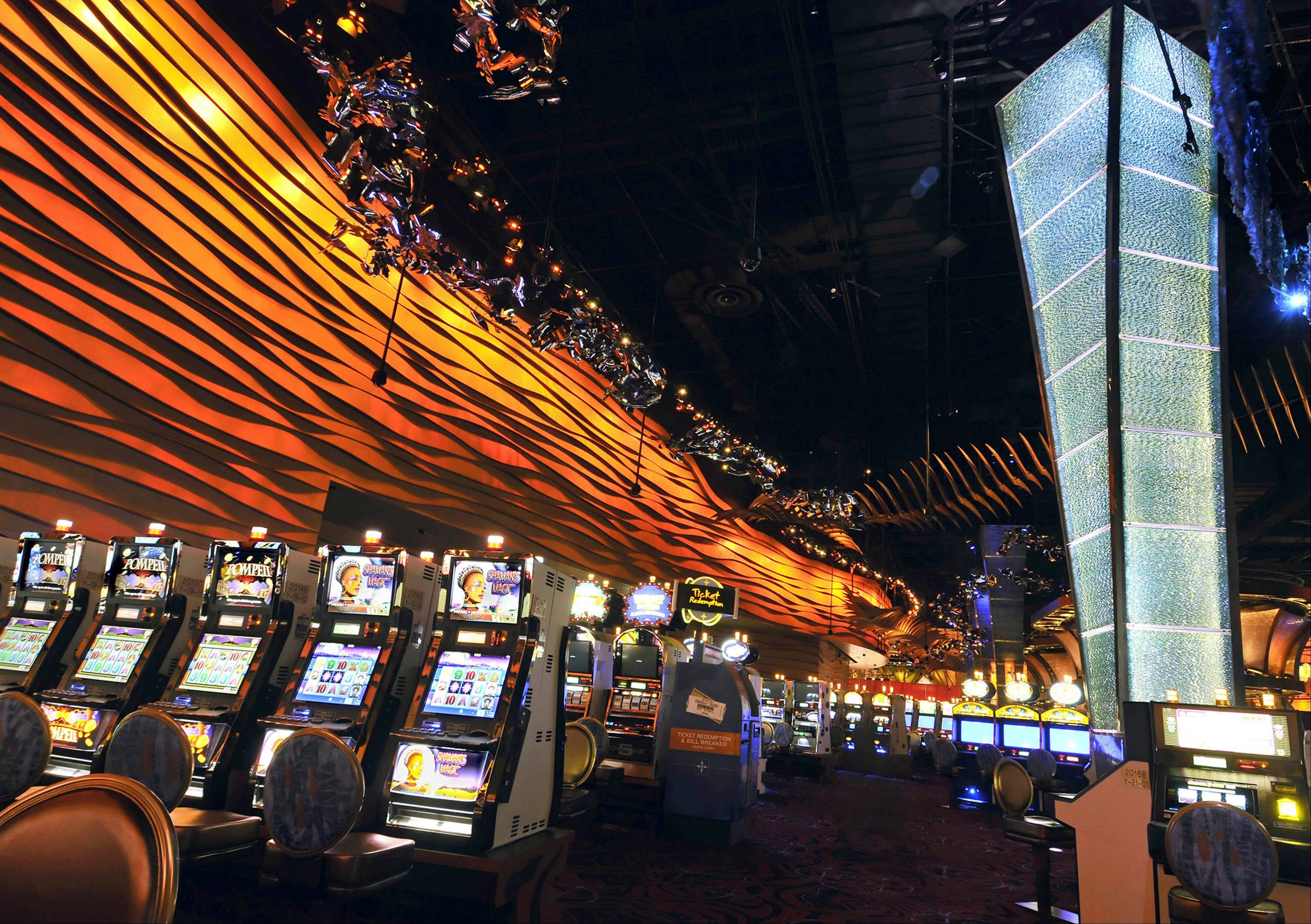 Slot machines are seen on the floor of the Casino of the Wind at Mohegan Sun in Uncasville, Conn. The spread of casino gambling is reaping billions of dollars for industry and government coffers, but also is creating more compulsive gamblers.