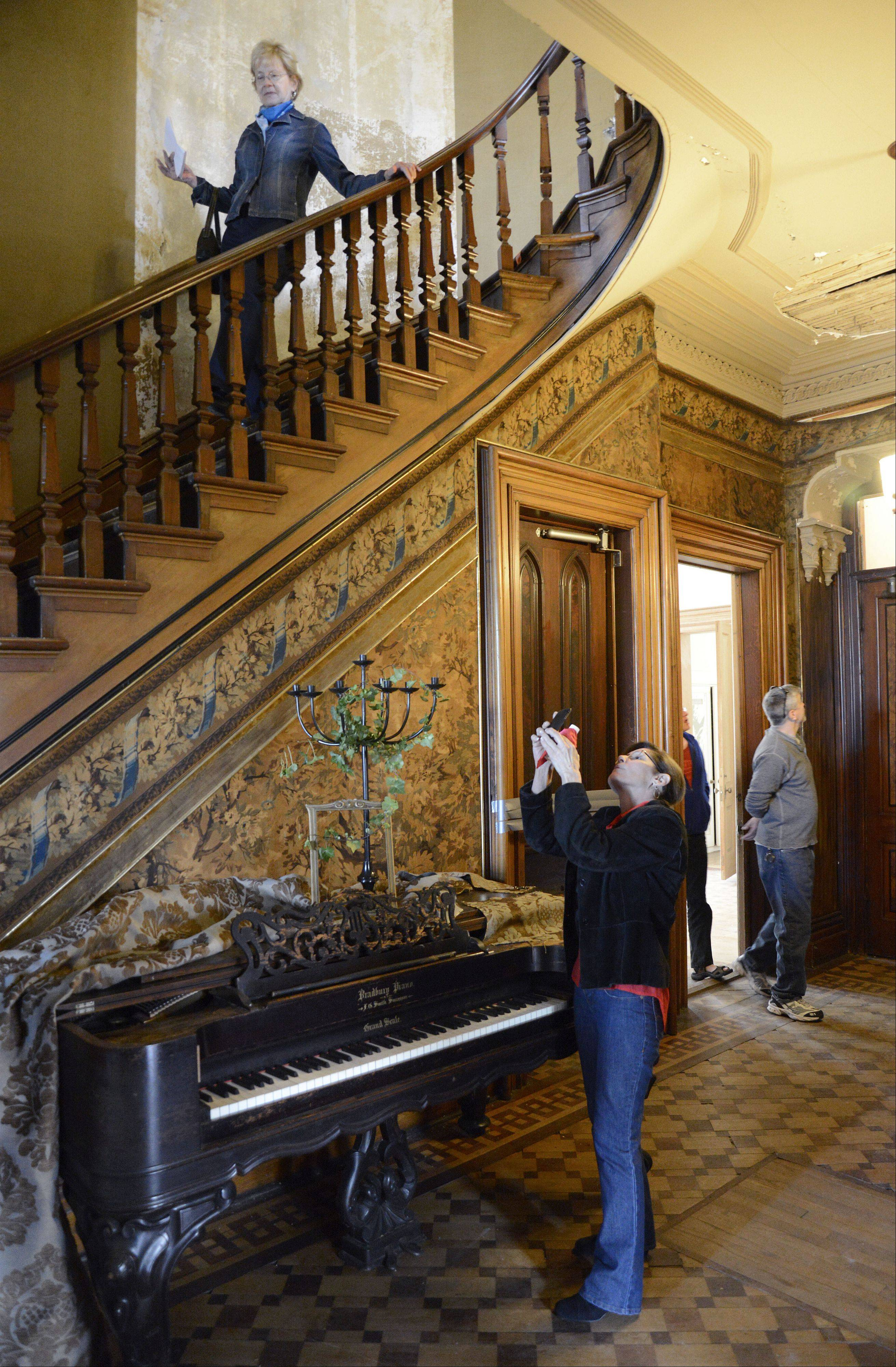 Catherine Forrest of South Elgin photographs the interior of the reception hall at Dunham Castle in Wayne on Saturday.