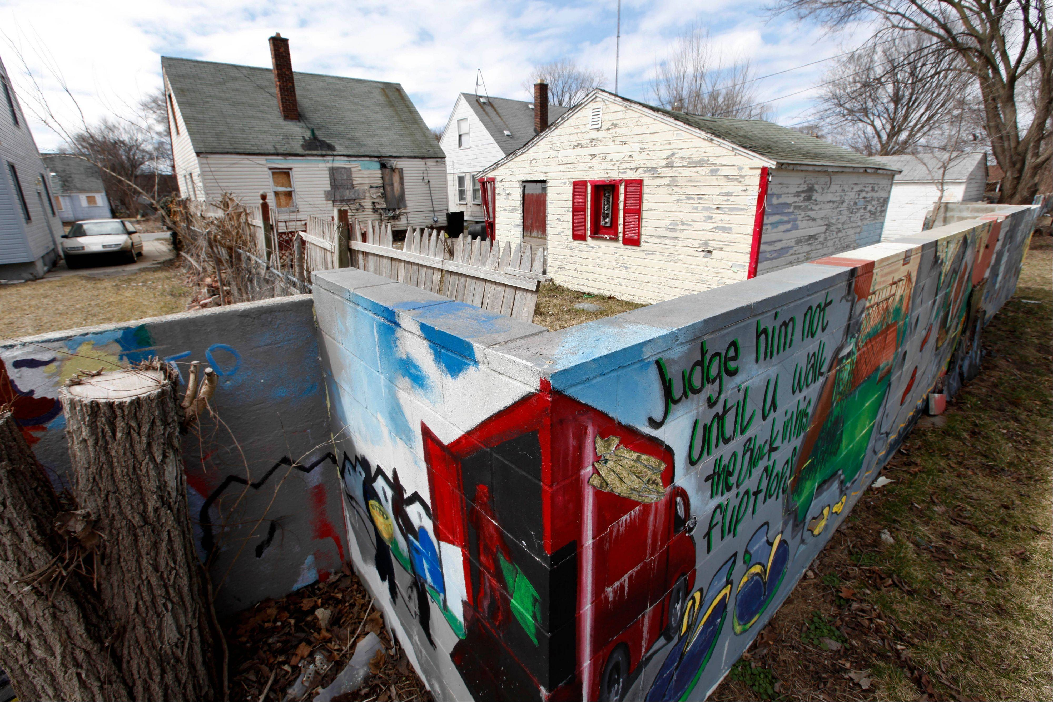 A section of a half-mile long concrete wall, six feet tall and a foot or so thick, built in the 1940s and now covered with murals. The wall was built to separate homes planned for middle-class whites from those owned by blacks. The wall remains, a physical embodiment of racial attitudes that the country long ago started trying to move beyond. And slowly, in subtle ways, it is evolving into something else in its community, something unexpected: an inspiration.