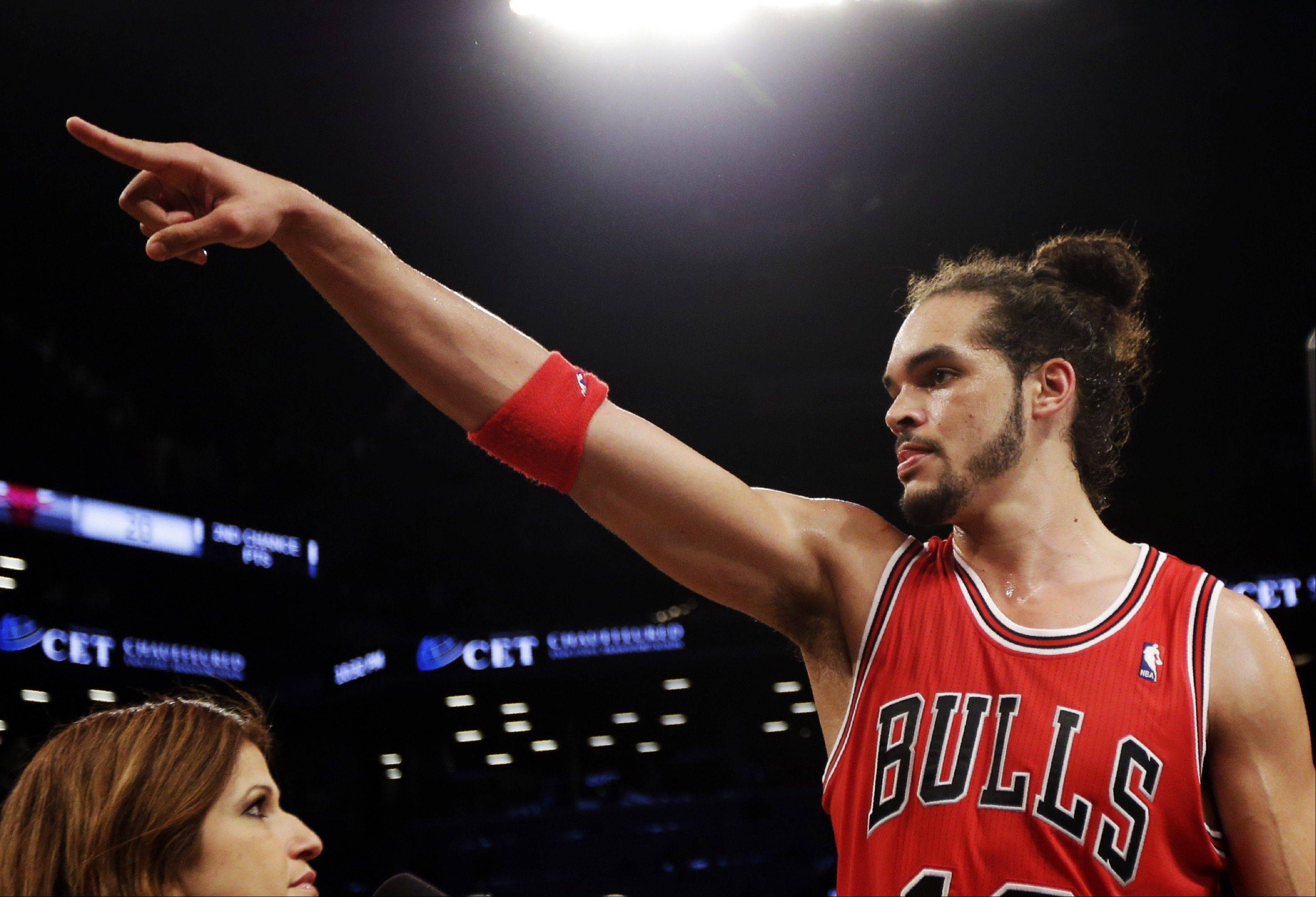 Joakim Noah celebrates with after defeating the Brooklyn Nets 99-93 in Game 7 of their first-round NBA basketball playoff series in New York, Saturday, May 4, 2013. The Bulls won the series to advance to a second-round series against the Miami Heat beginning Monday.