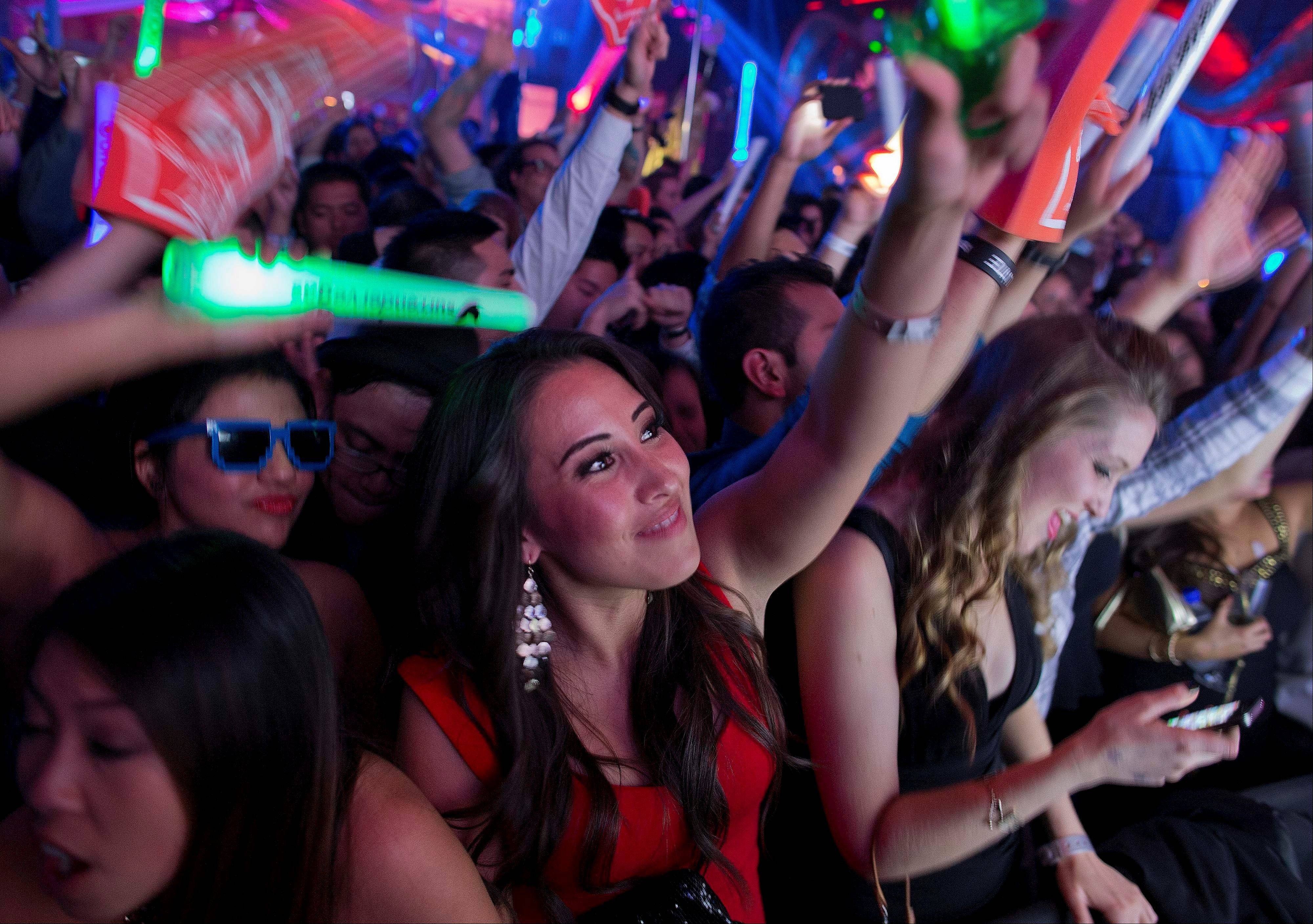 Revelers dance to the music played by DJ Cedric Gervais at the Surrender nightclub in Las Vegas. The rise of the Vegas super-club coincides with the decline of the town's gambling supremacy.