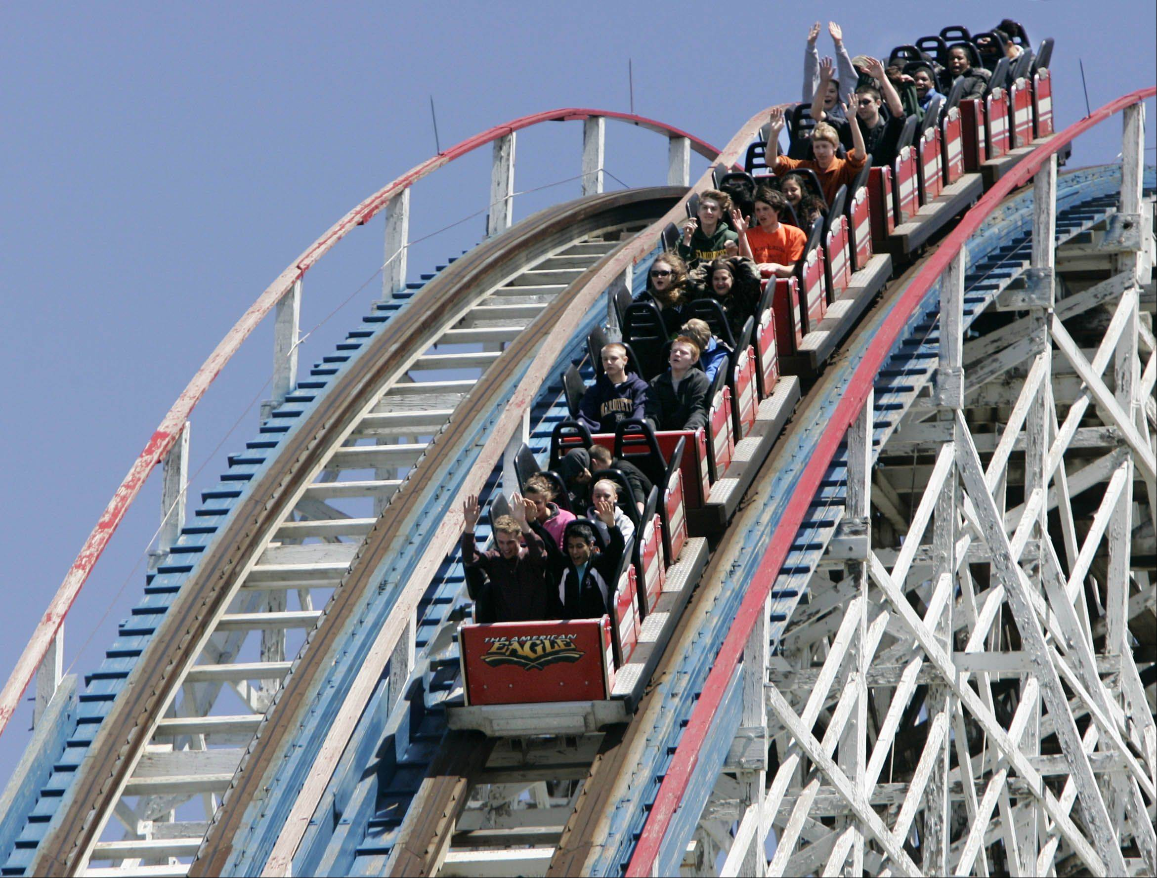 Coaster enthusiasts ride the American Eagle roller coaster at Six Flags Great America in Gurnee. Great America's opening day is Saturday, May 4.