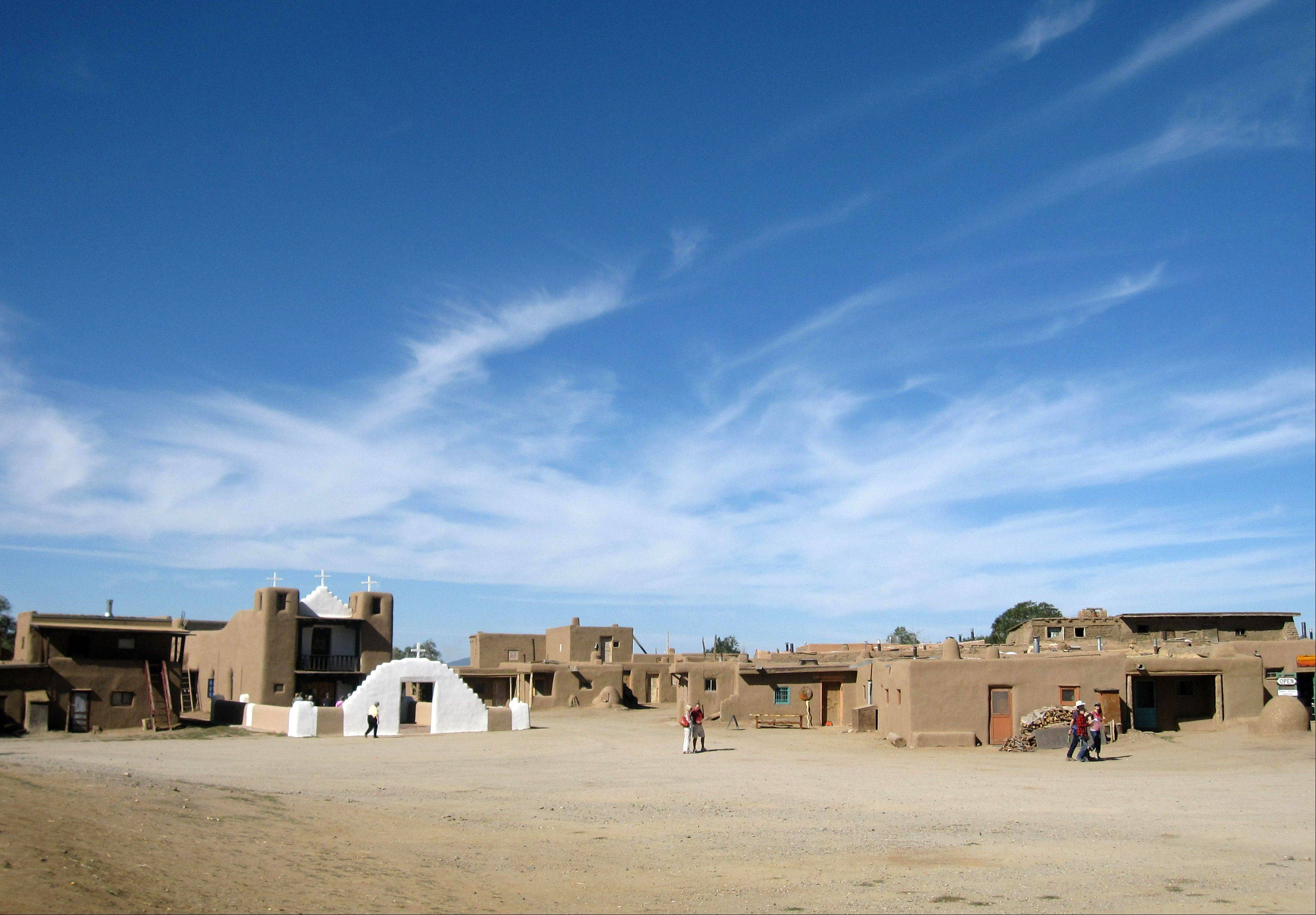 Tours of the Taos Pueblo in Taos, N.M., describe the community's survival and challenges across the centuries.