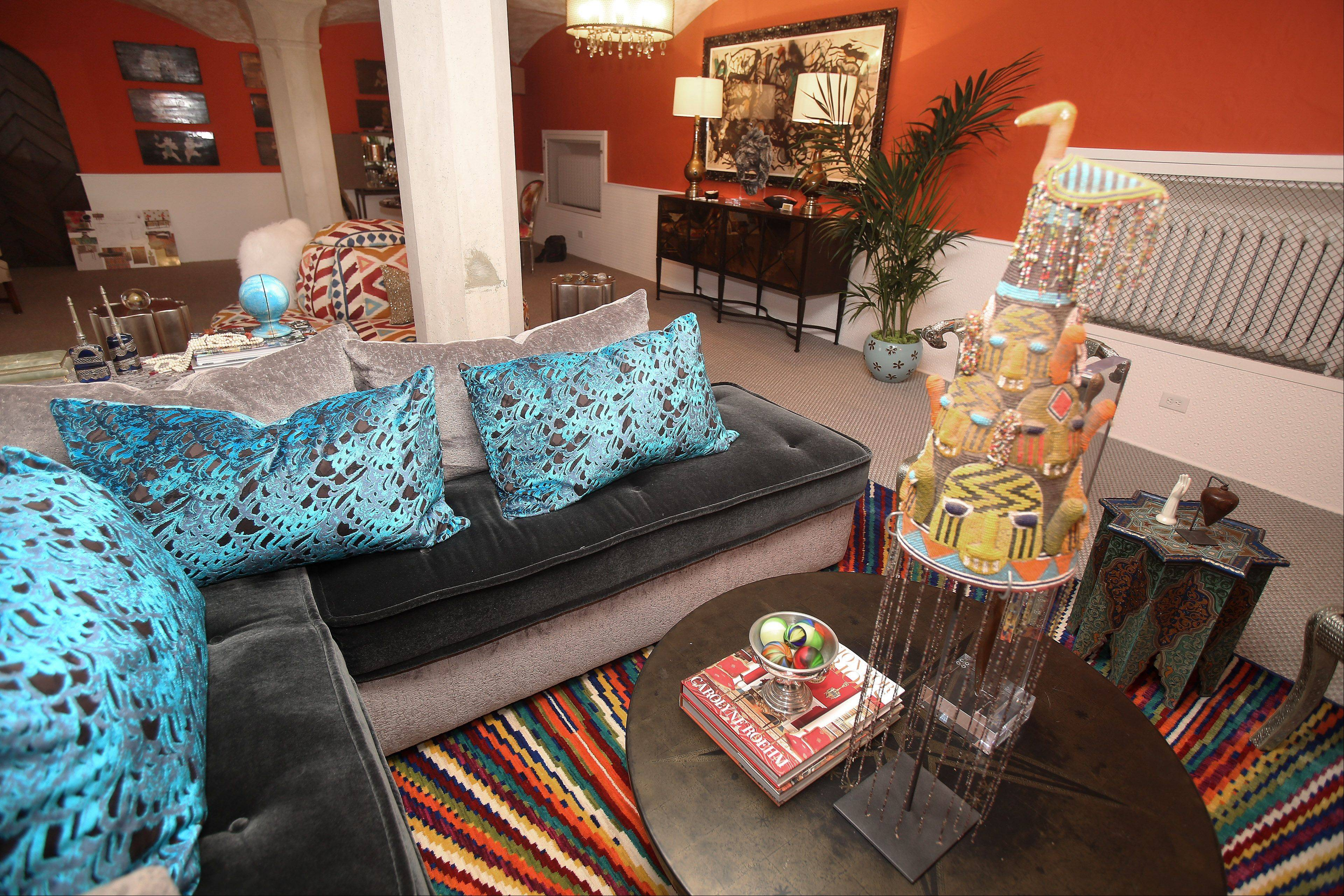 Check out the pillows and the rosy orange walls in the Party Room by Julia Buckingham Edelmann of Chicago.