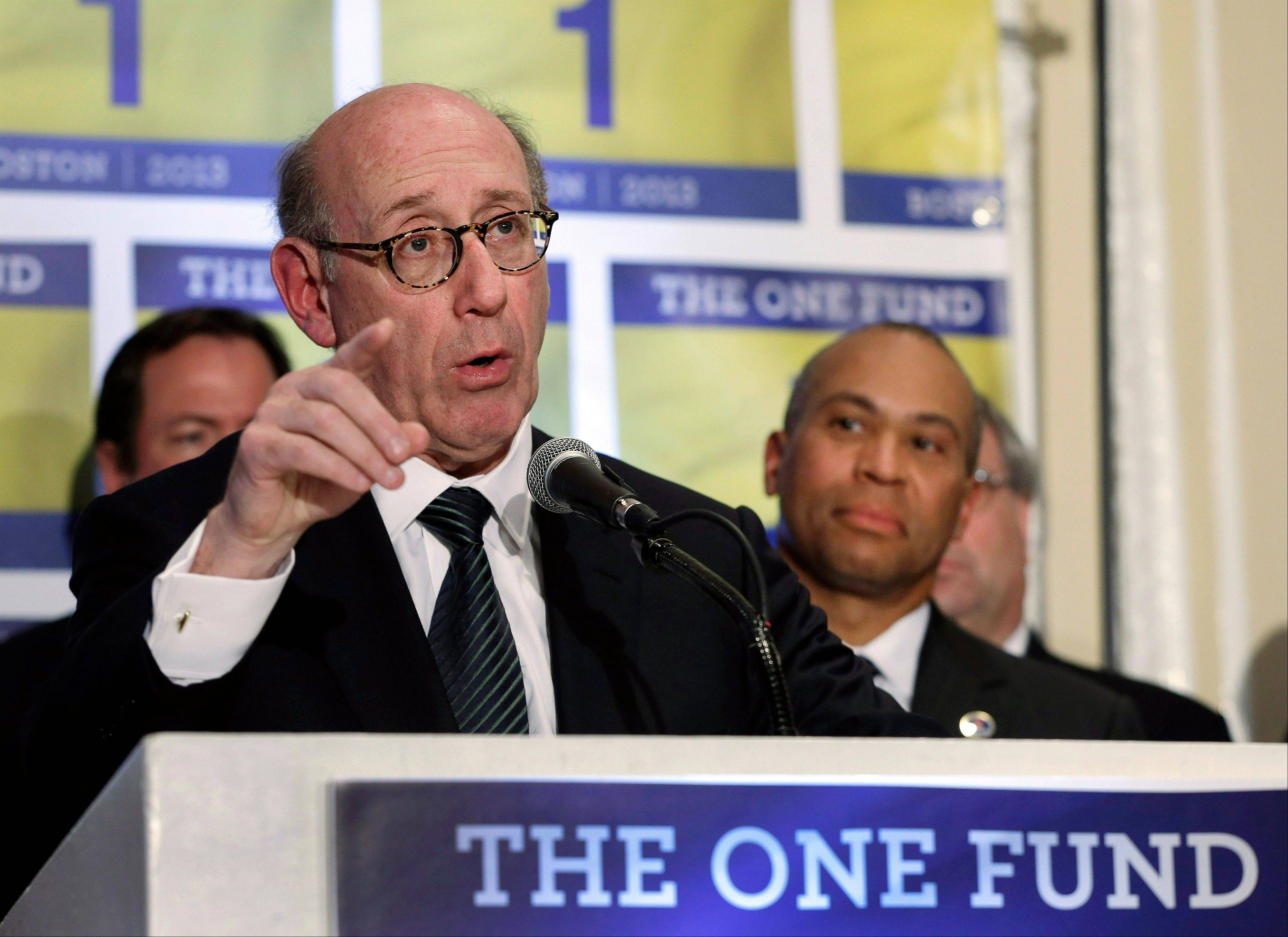 Kenneth Feinberg, an attorney who managed the 9/11 Victim Compensation Fund, spoke two weeks ago at a news conference in Boston as Massachusetts Gov. Deval Patrick, right, listened. The One Fund was established by Patrick and Boston Mayor Thomas Menino as a central place to gather donations for the Boston Marathon bombing victims.