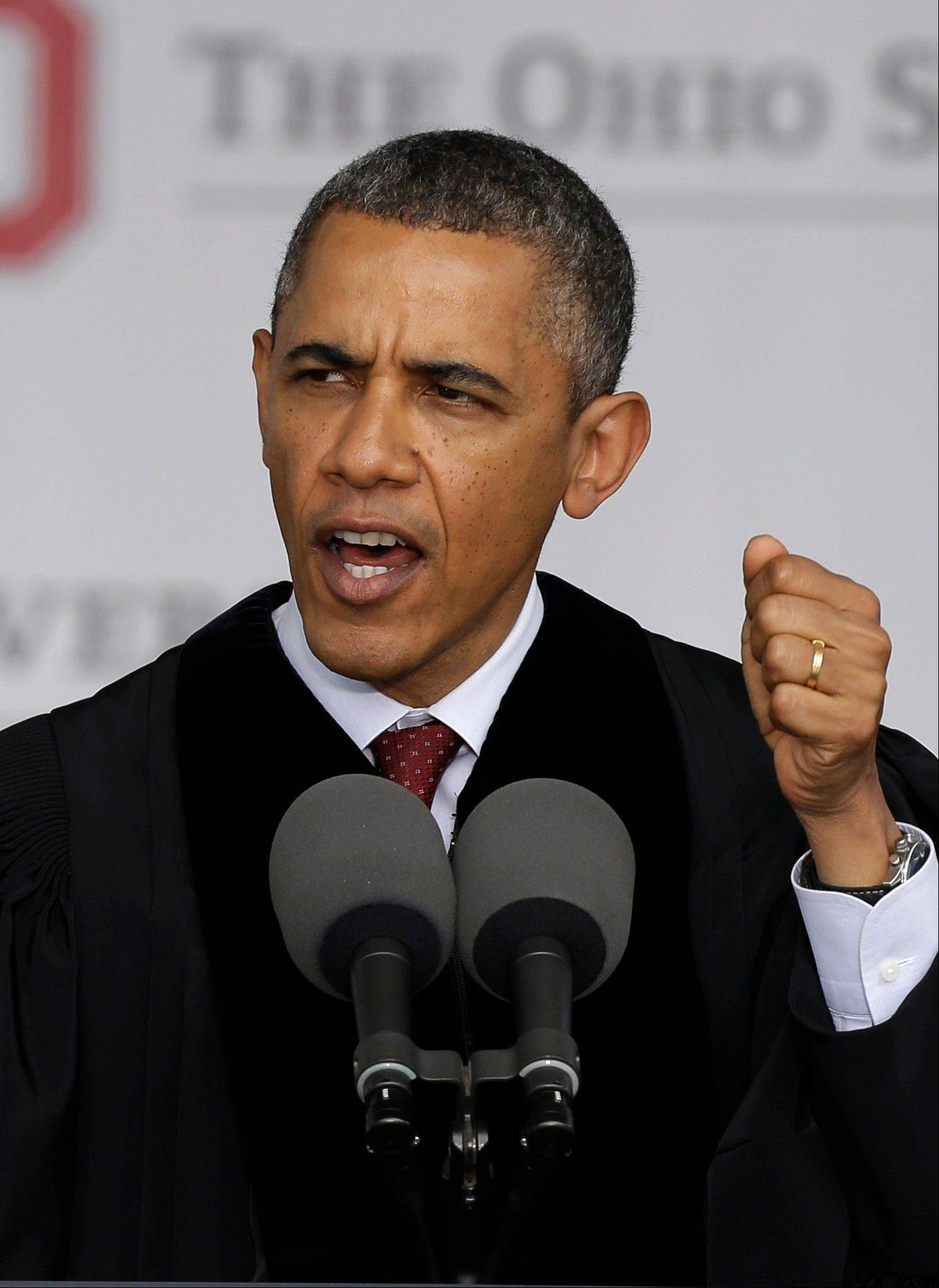 President Barack Obama speaks at Ohio State University's spring commencement ceremony Sunday in Columbus, Ohio. Obama urged graduating students to be active citizens, to fight for causes they believe in, and to be better than generations before them.