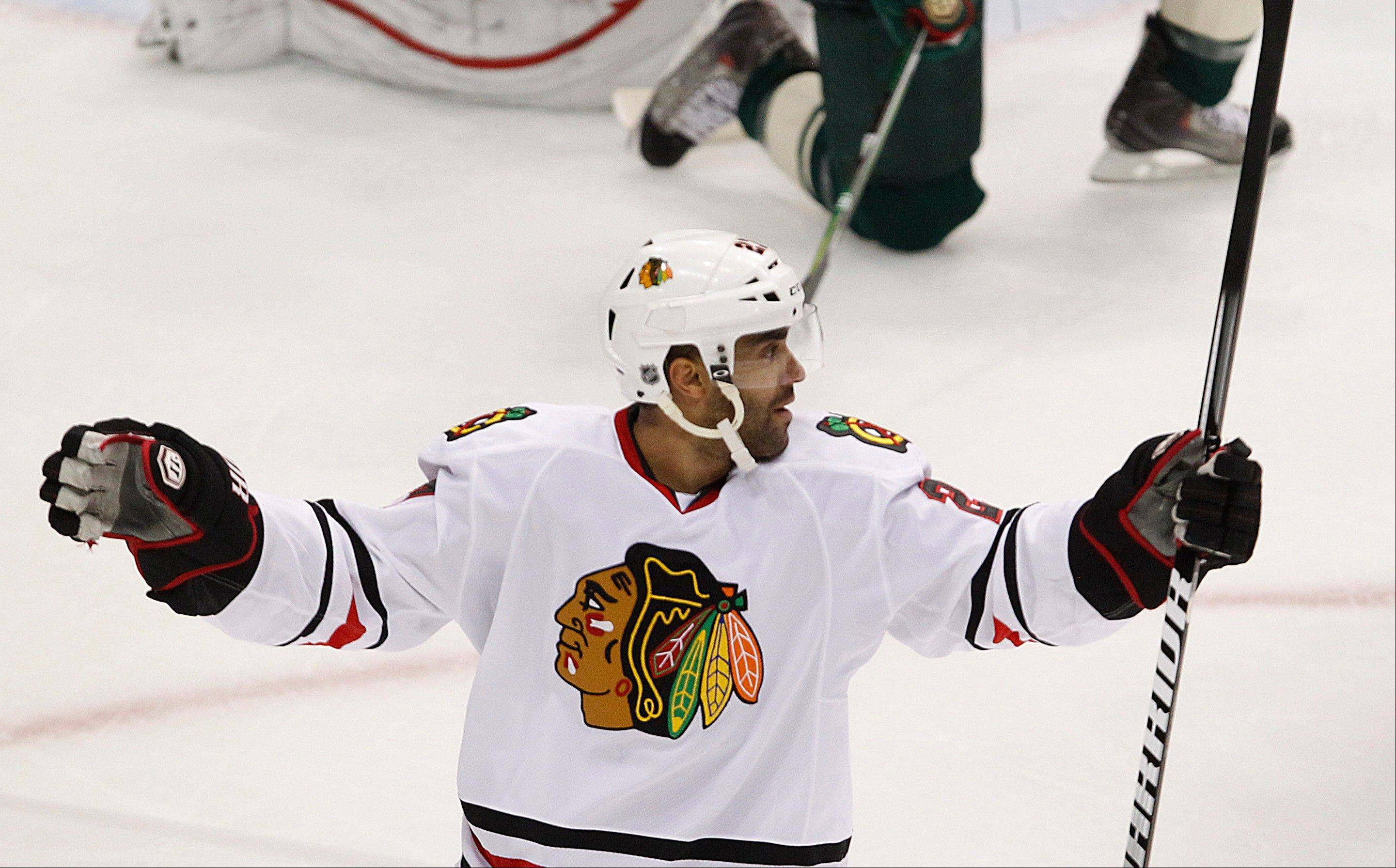 Chicago Blackhawks' Johnny Oduya celebrates his goal against Minnesota Wild goalie Josh Harding in the first period.