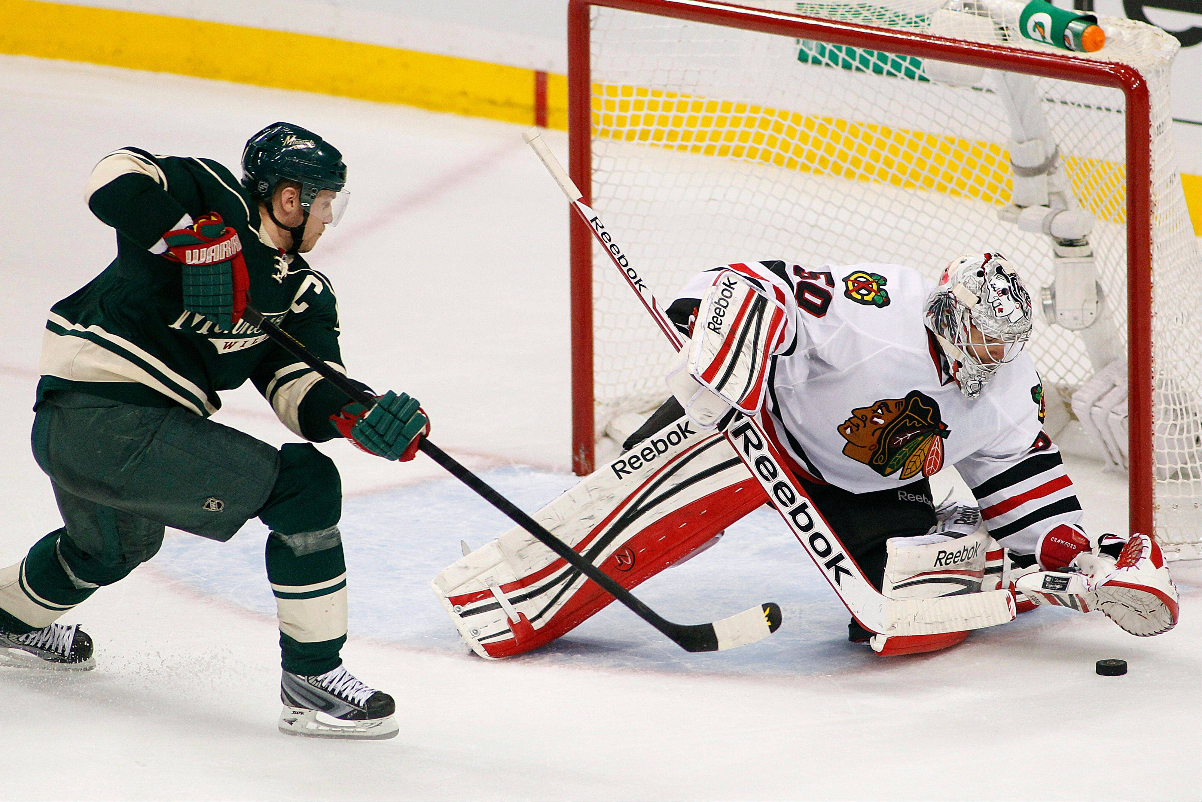 Minnesota Wild's Mikko Koivu has his shot stopped by Chicago Blackhawks goalie Corey Crawford in the third period. The Wild won 3-2.