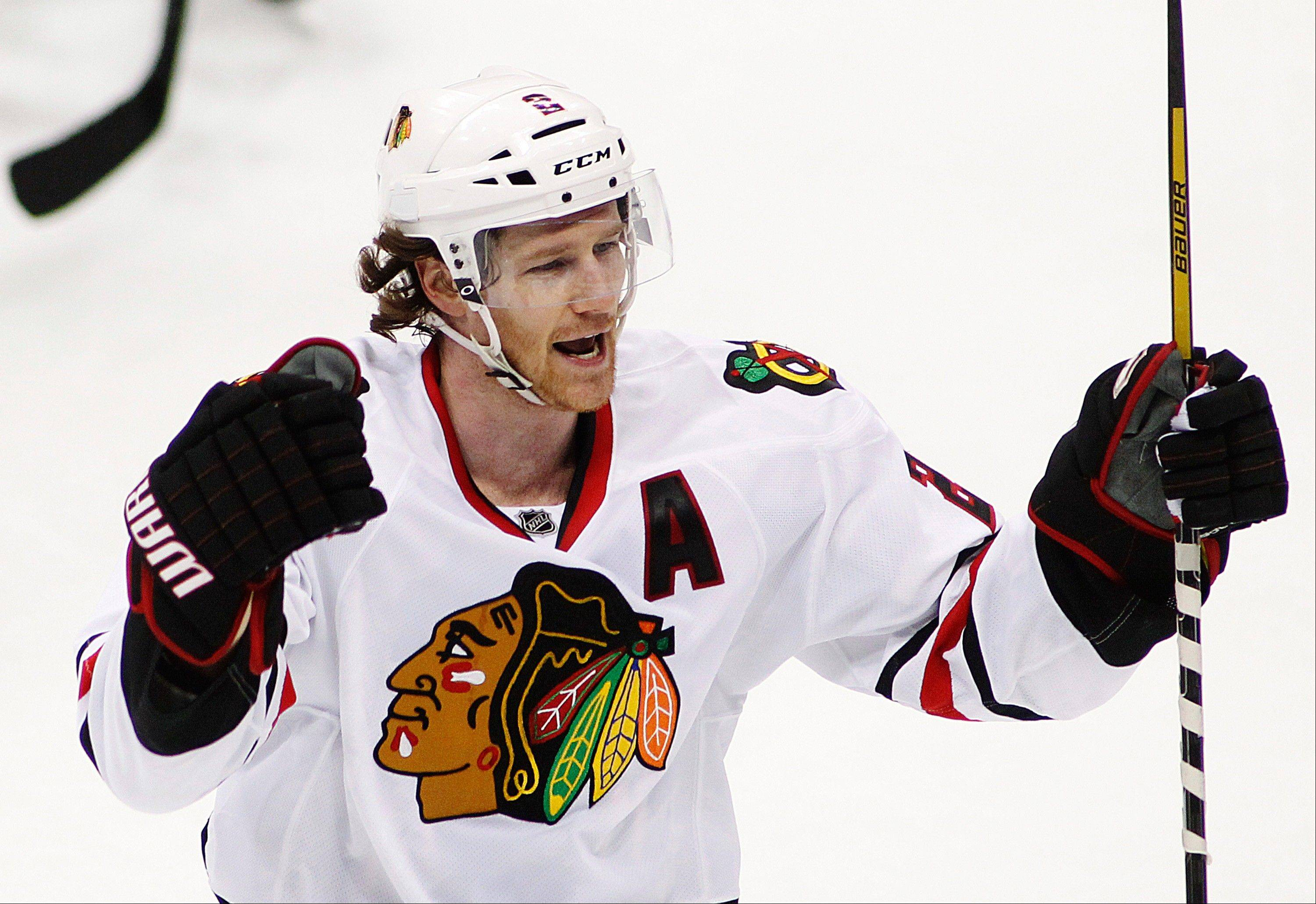 Chicago Blackhawks' Duncan Keith celebrates his goal in the third period. The Wild won 3-2.