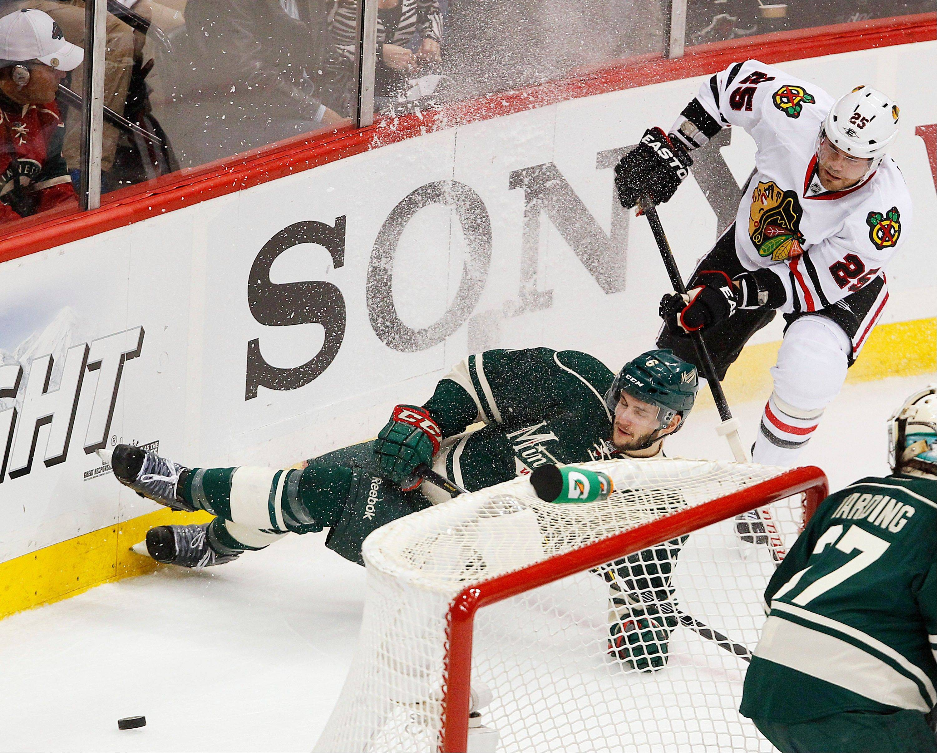 Chicago Blackhawks' Viktor Stalberg takes down Minnesota Wild's Marco Scandella in the first period.
