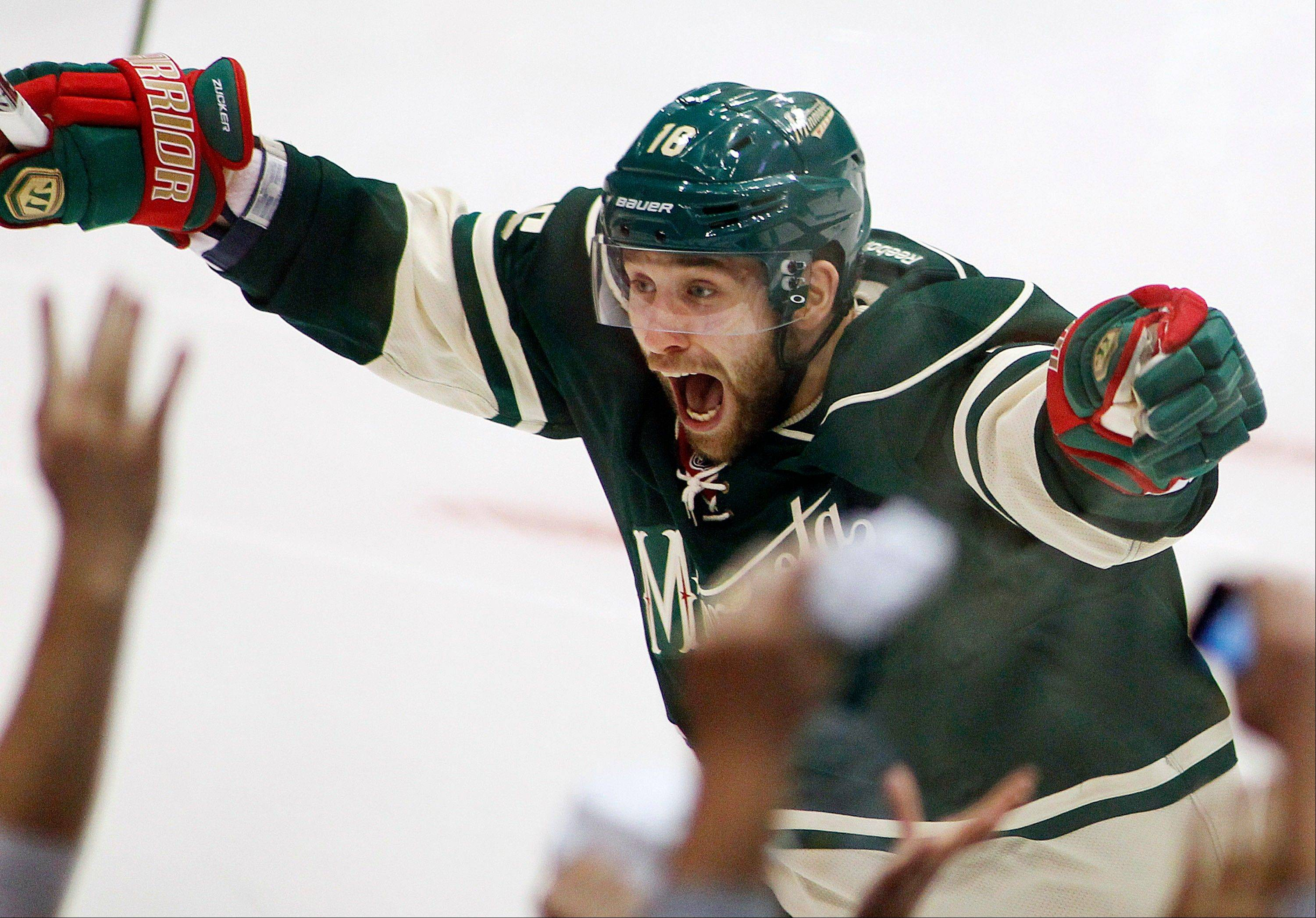 Minnesota Wild's Jason Zucker celebrates his overtime goal against the Chicago Blackhawks in Game 3. The Wild won 3-2.