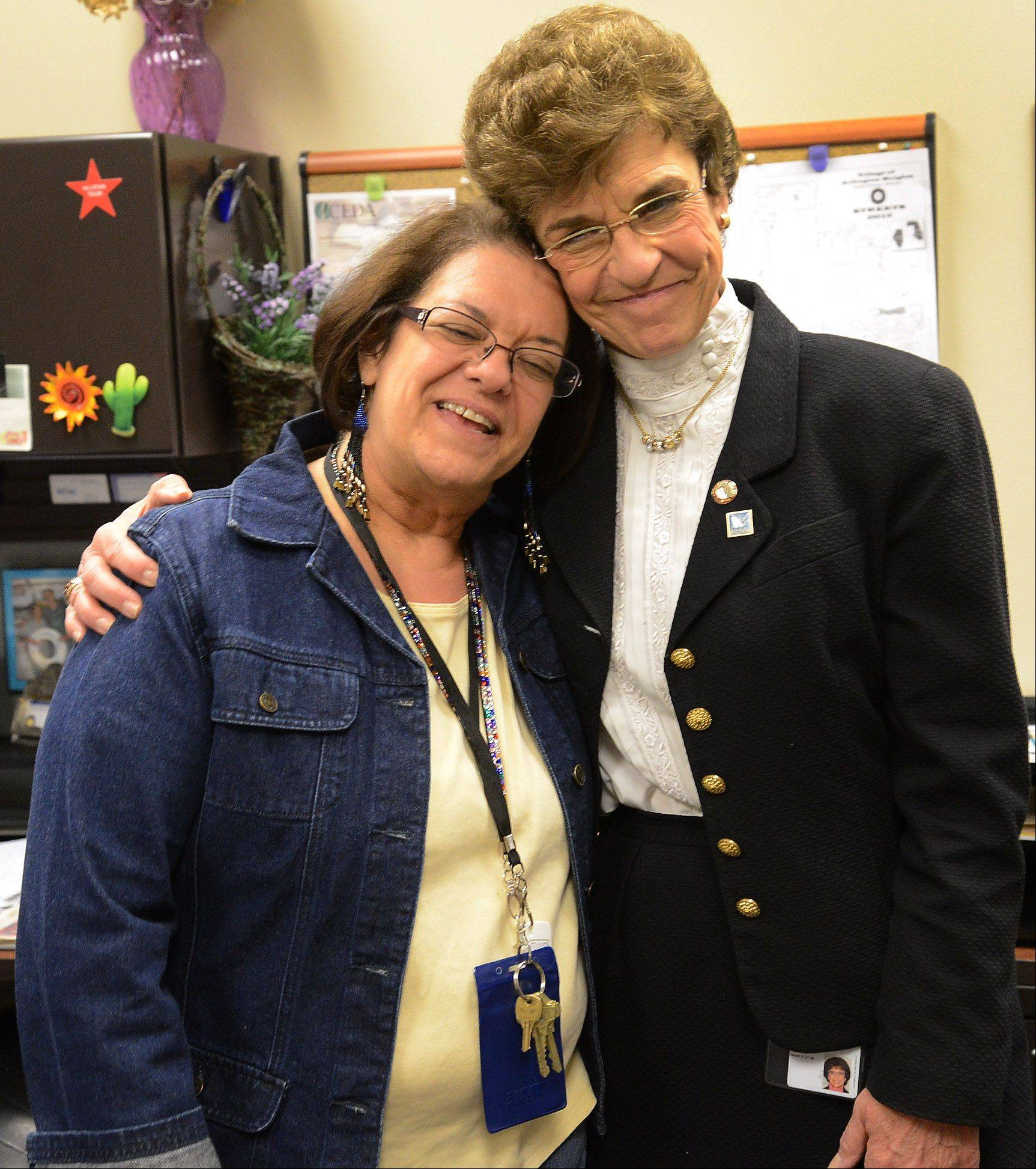 Outgoing Arlington Heights Mayor Arlene Mulder with Carol Janacek, human services coordinator.