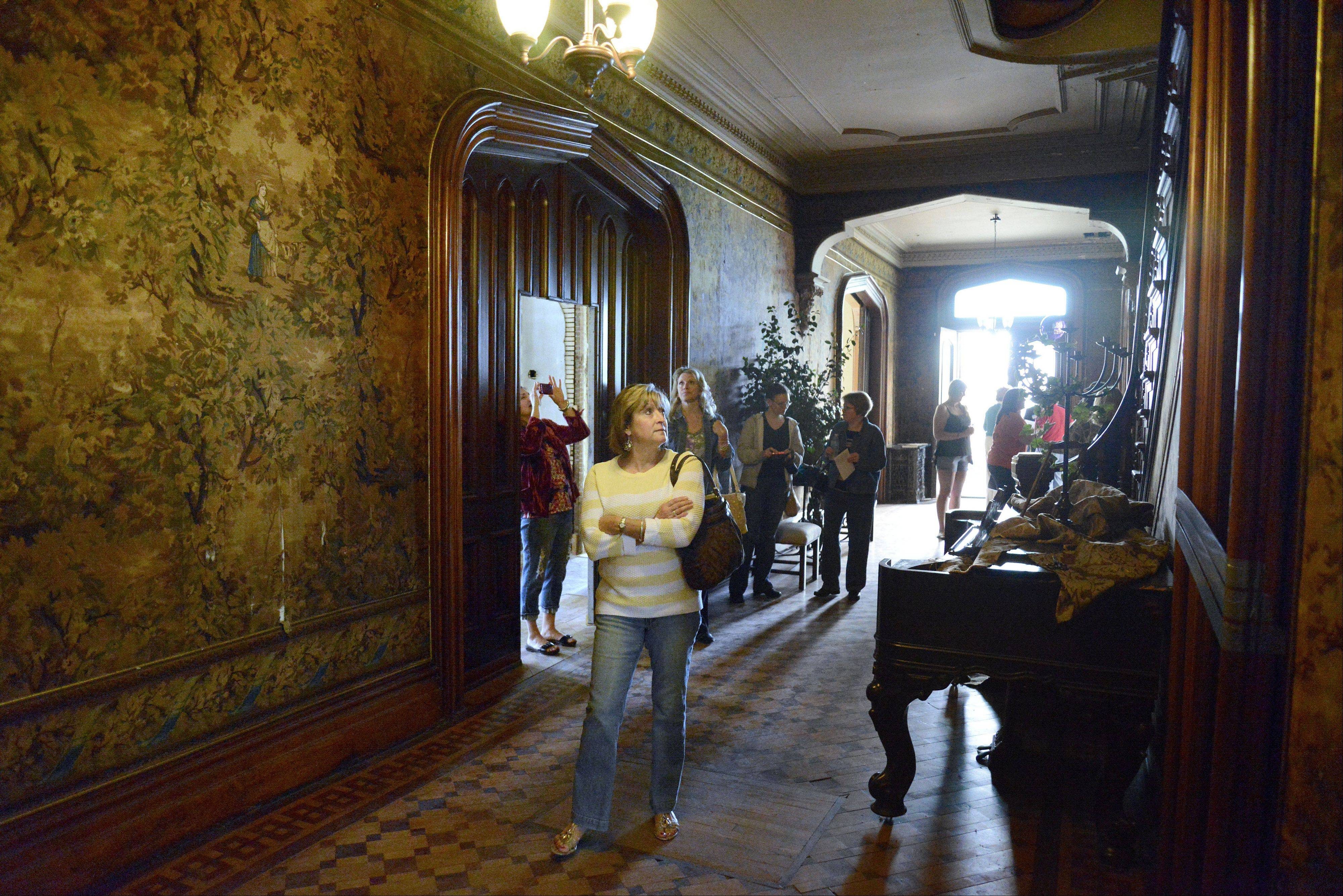Christina Beasley of Wayne walks through the reception hall of Dunham Castle in Wayne on Saturday. Tours continue 11 a.m. to 3 p.m. today.