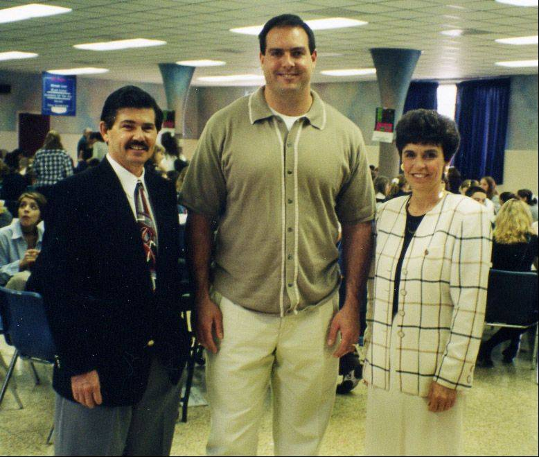Arlene Mulder at St. Viator High School in May 1997 with Cook County Clerk David Orr, left, and Chicago Bear Andy Heck. Heck was sworn in as a deputy voter registrar and the three came to St. Viator to discuss the importance of voting.